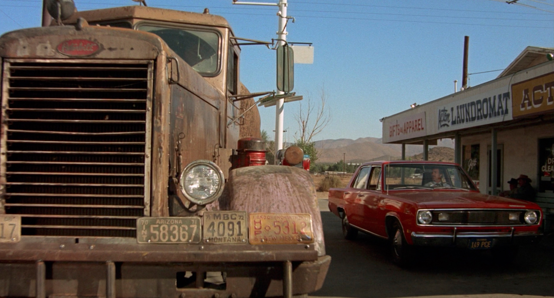 1971 Plymouth Valiant beside tanker truck