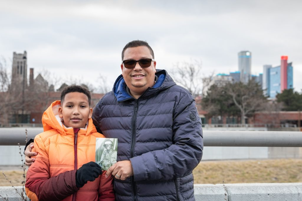 Gregory Qualls and son holding photo detroit