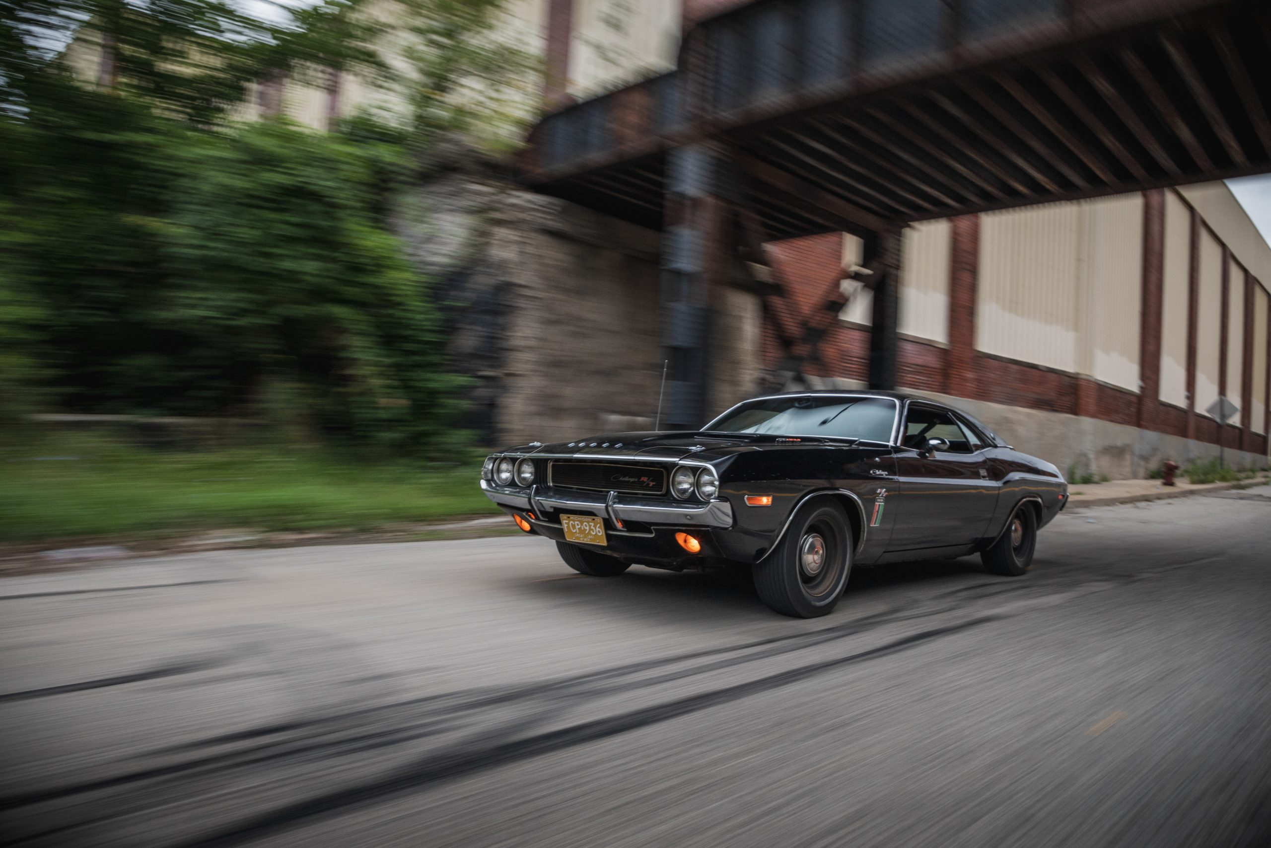 black ghost challenger front three-quarter action