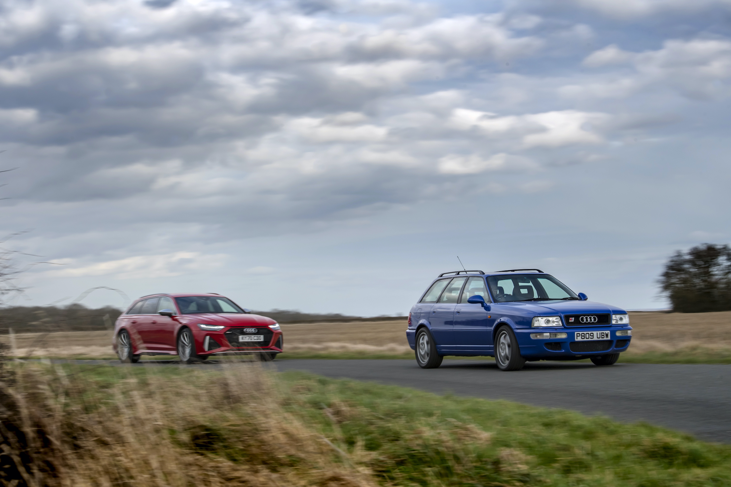 Audi RS2 leading RS6 countryside drive action