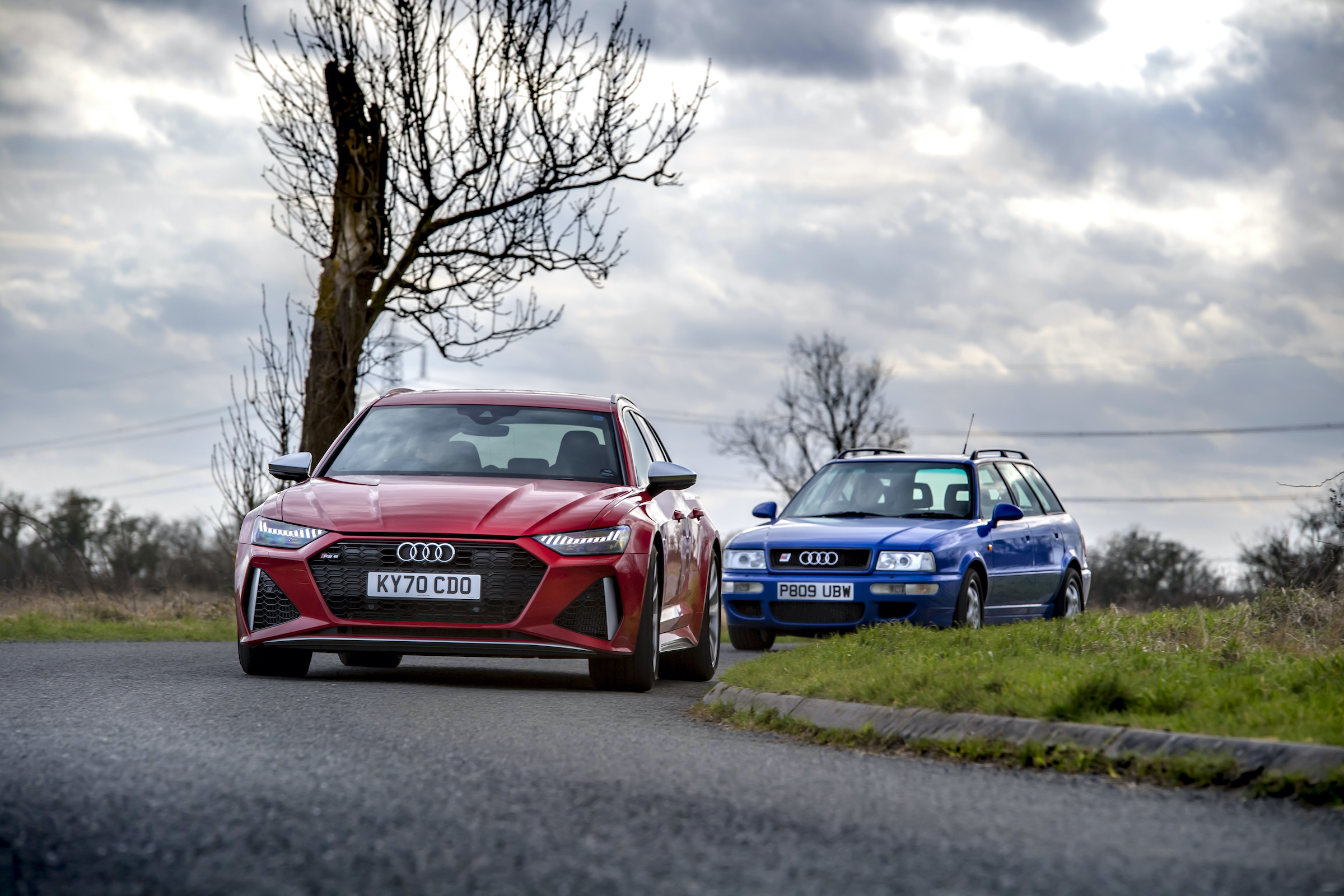 Audi RS6 leading RS2 cornering driving action