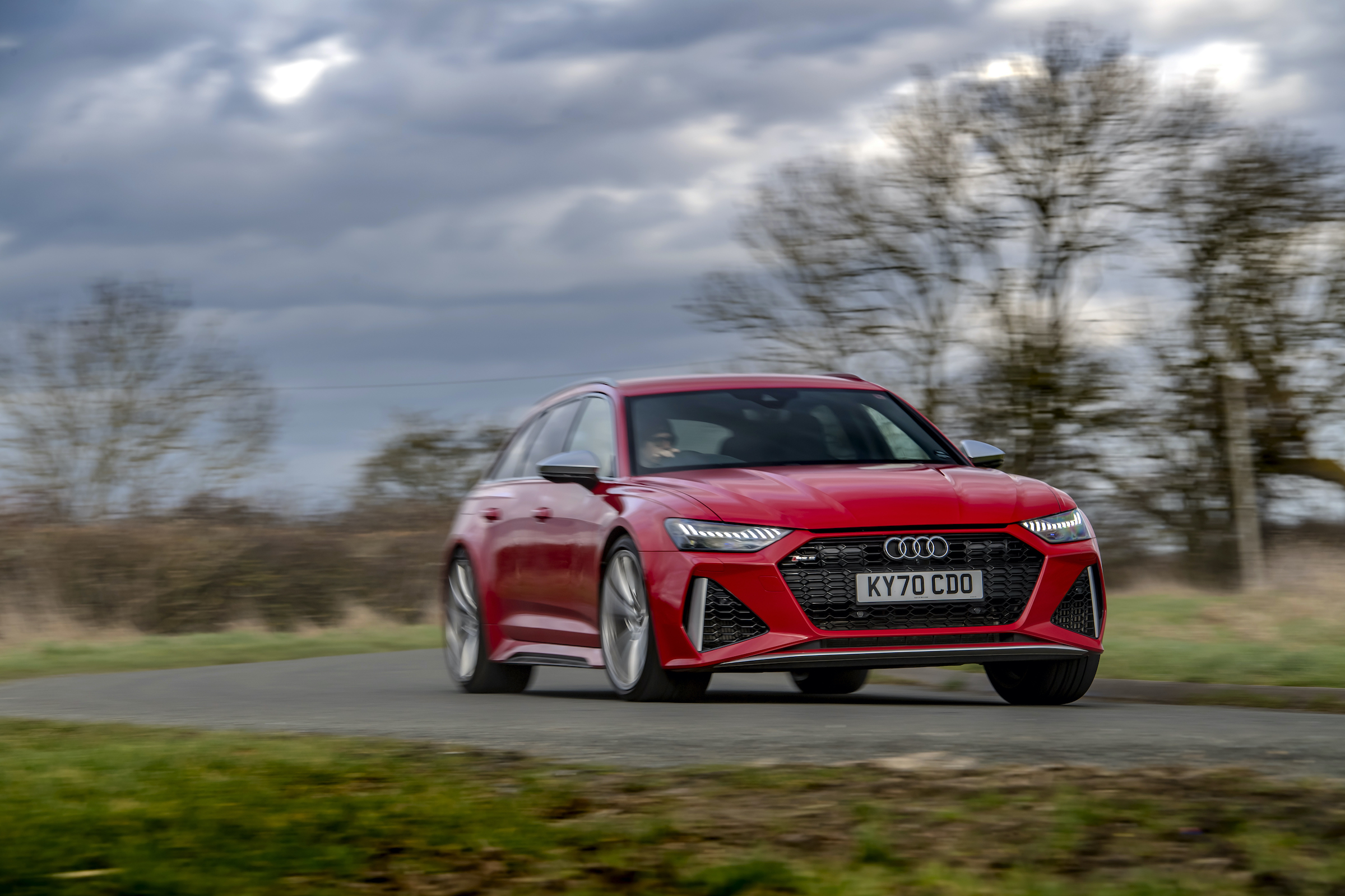 Audi RS6 front three-quarter dynamic driving action