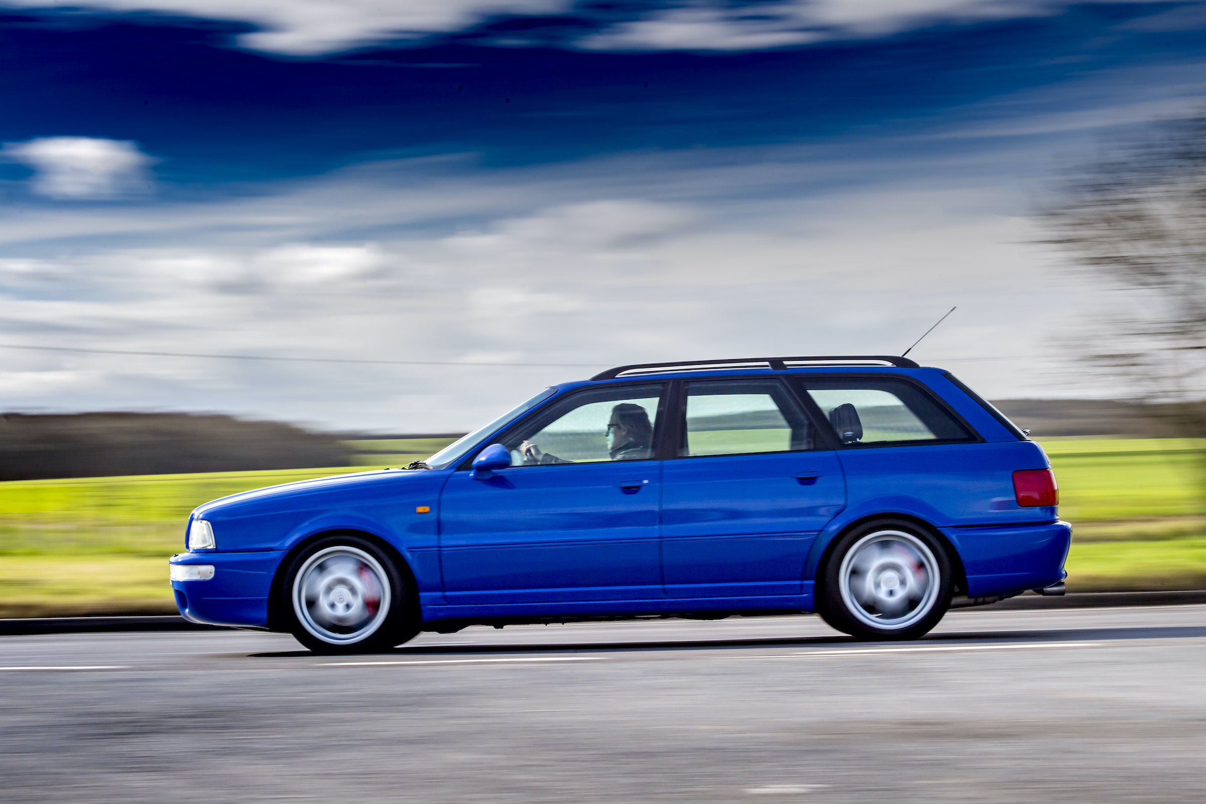 Audi RS2 side profile driving dynamic action