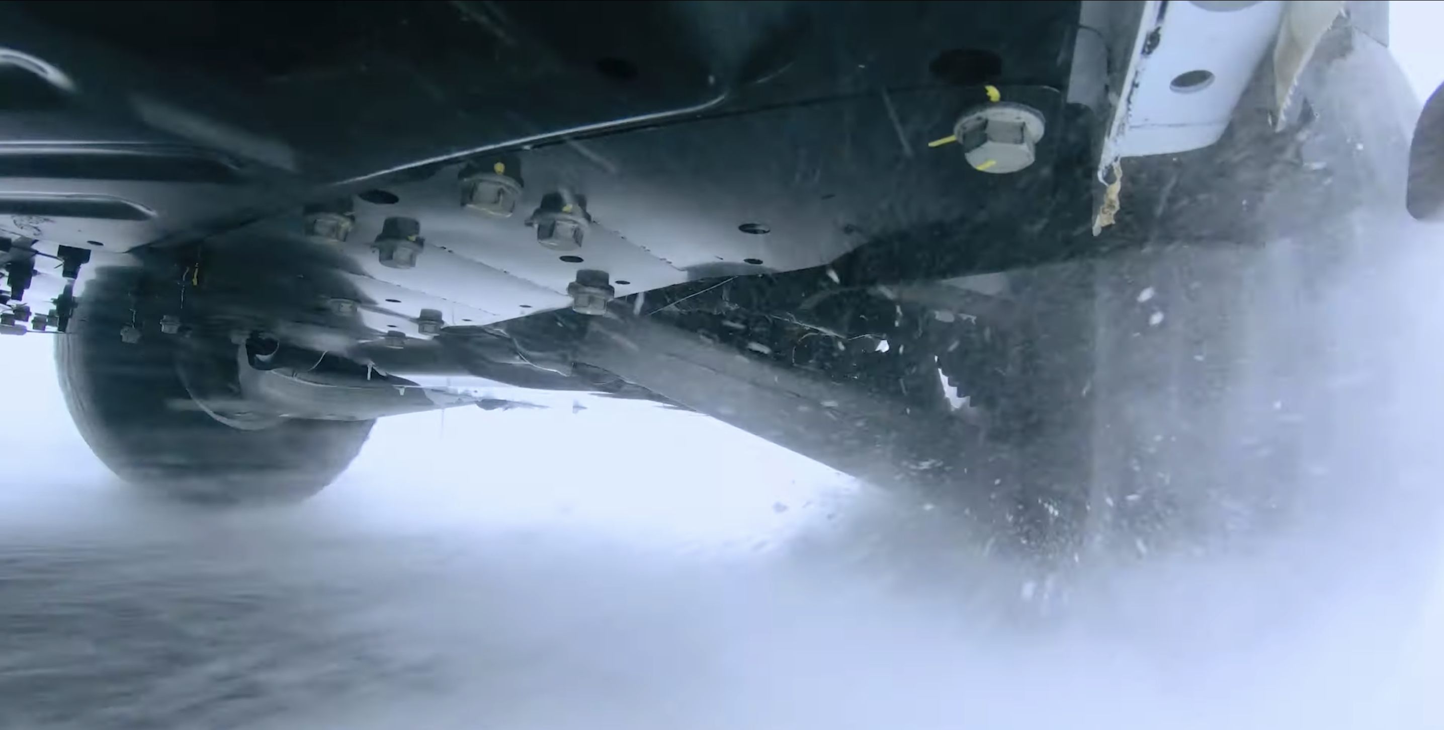 Hummer EV pickup winter testing underbody suspension