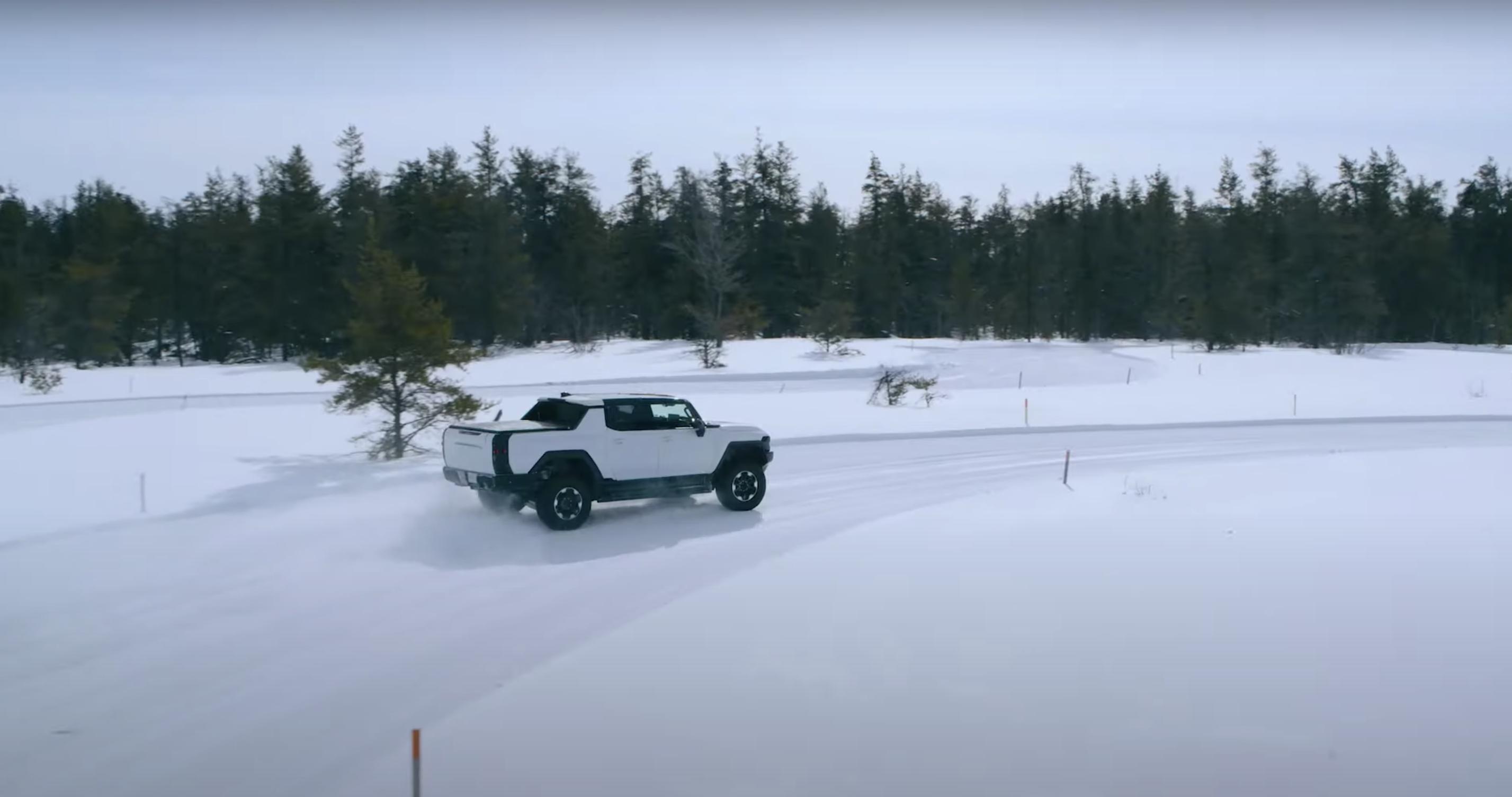 Hummer EV pickup winter testing rear camo snow