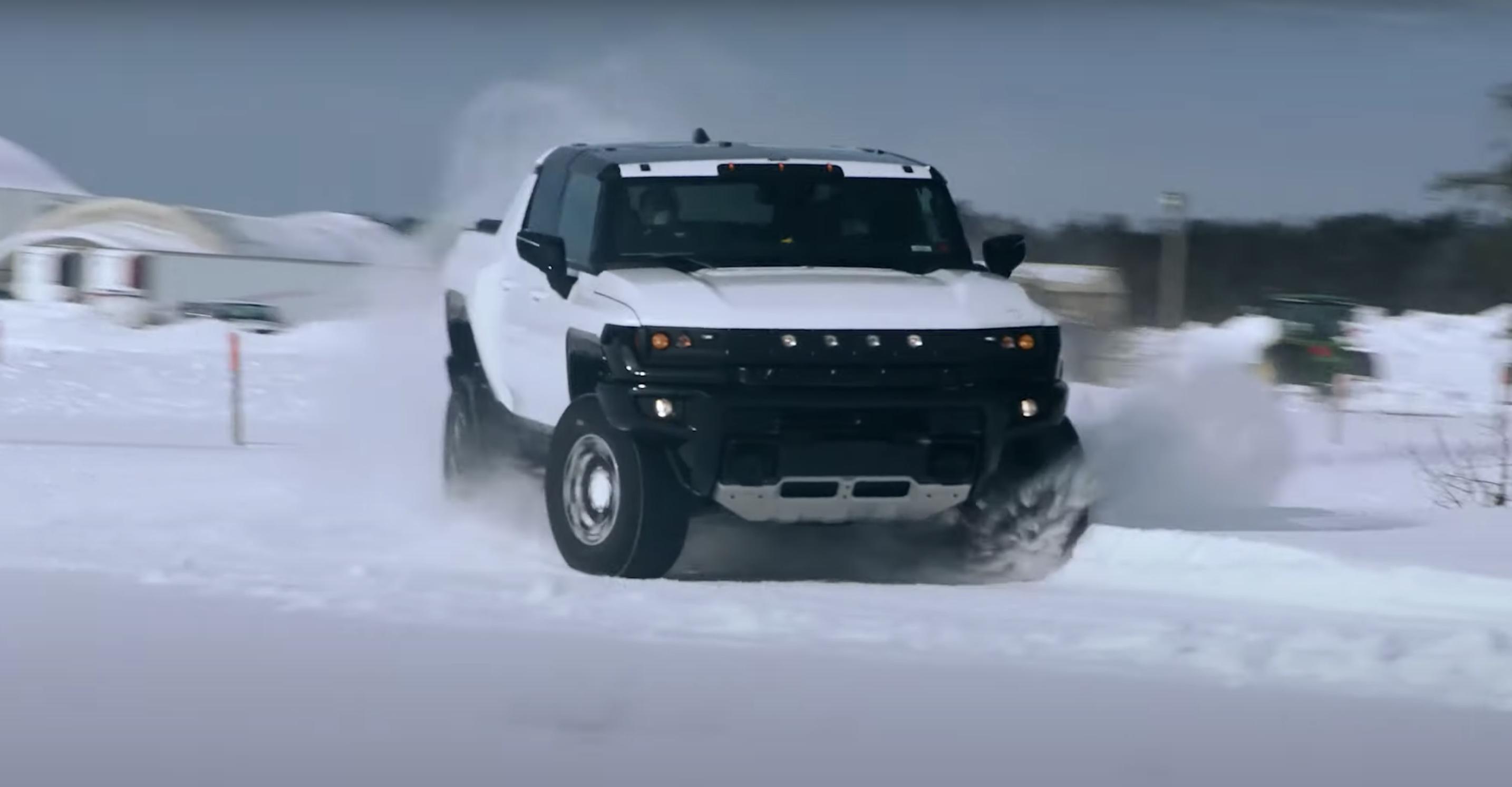Hummer EV pickup winter testing front camo snow drift