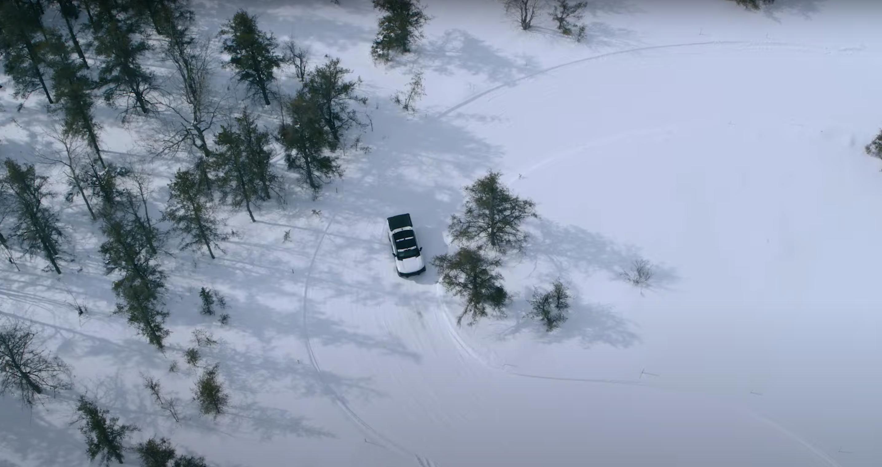 Hummer EV pickup winter testing overhead camo snow