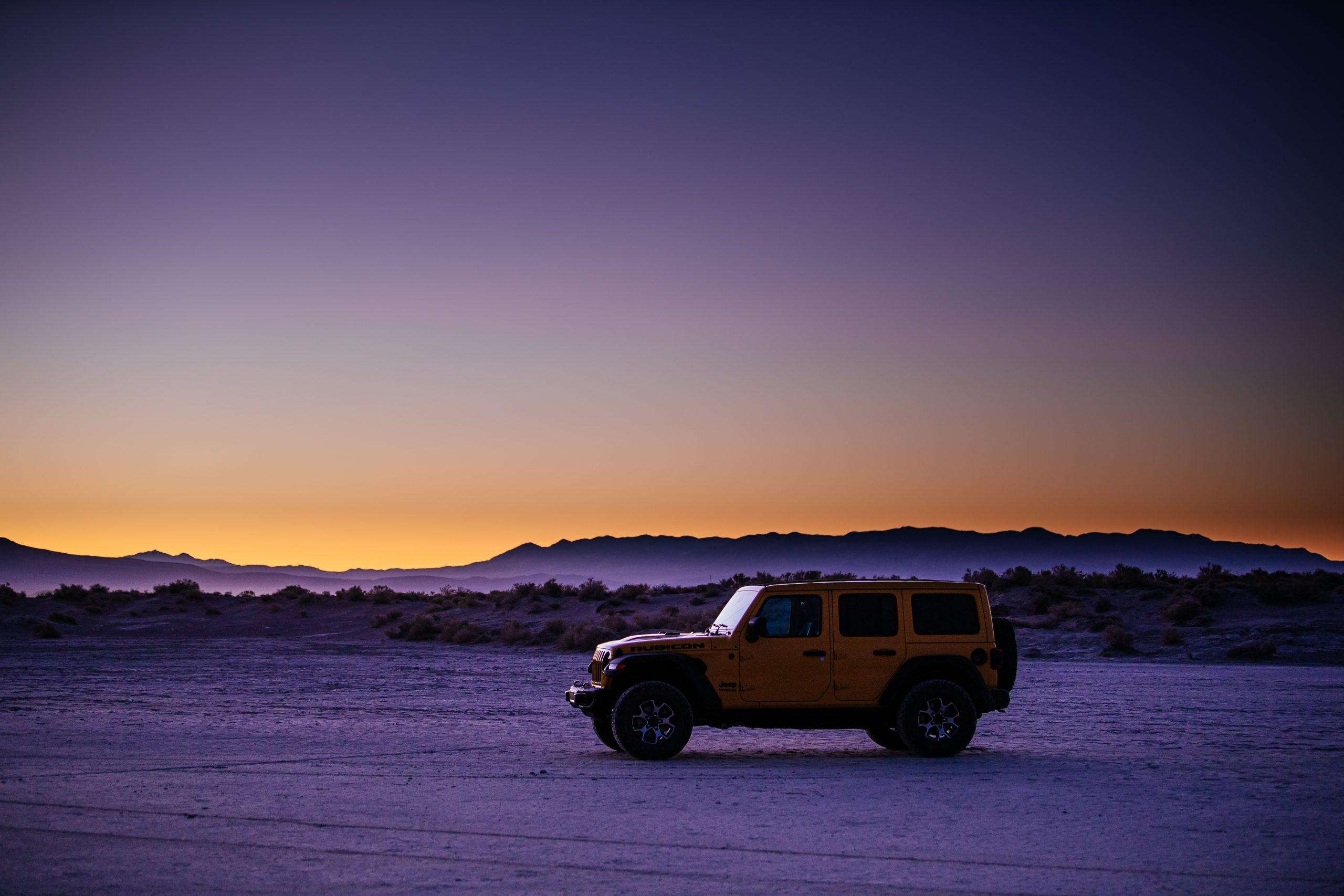 jeep wrangler rubicon side profile on desert flat at sundown