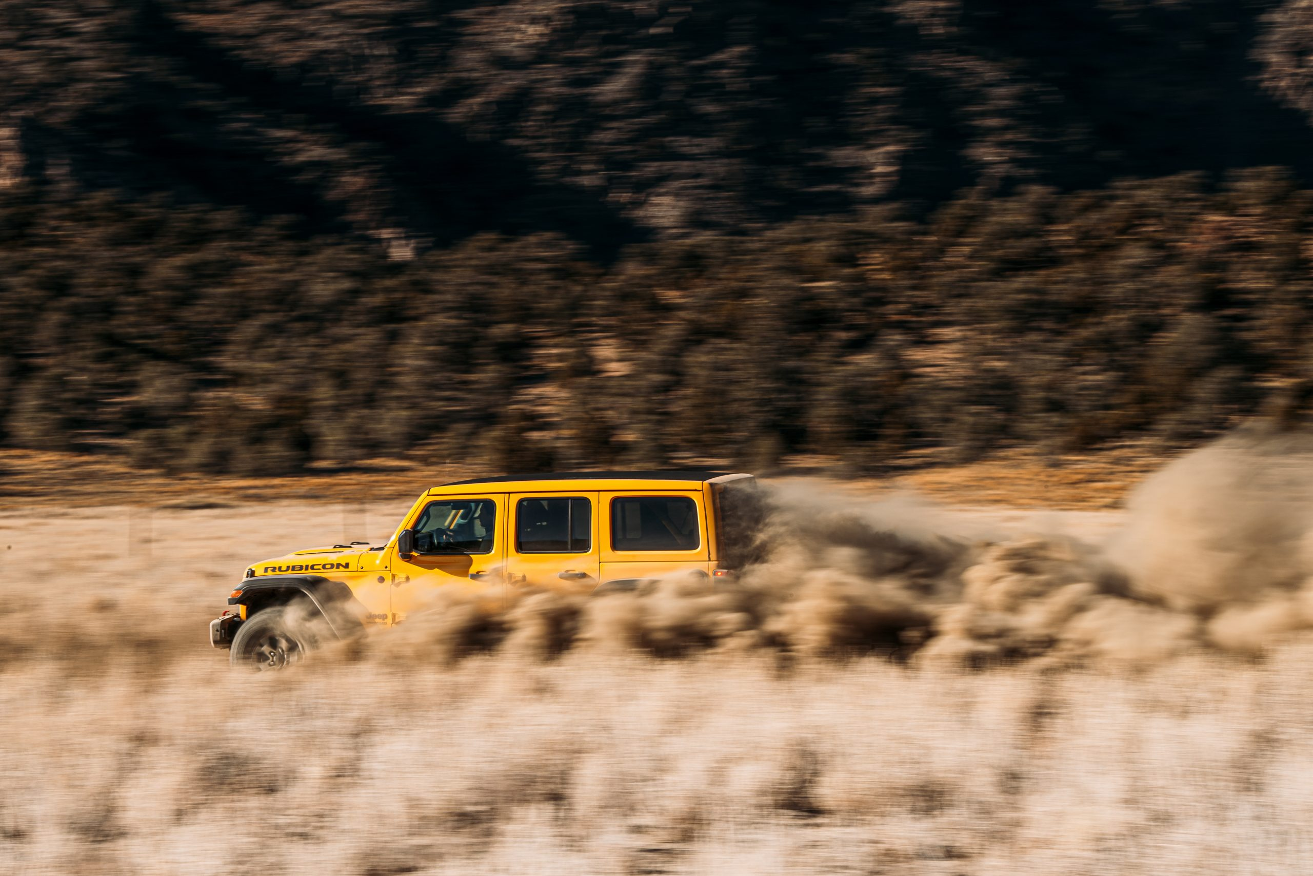 jeep wrangler rubicon off-road trail dust dynamic action