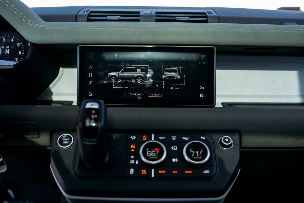 land rover defender interior infotainment screen on dash drive modes