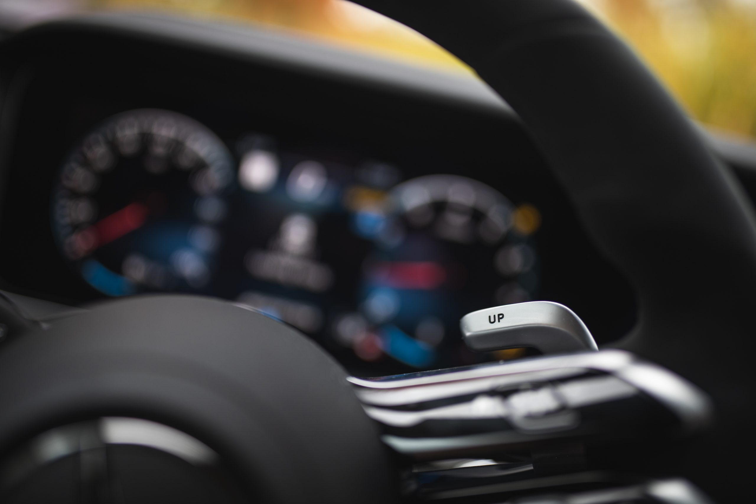 2021 Mercedes-AMG E63 S interior wheel paddle shifter detail