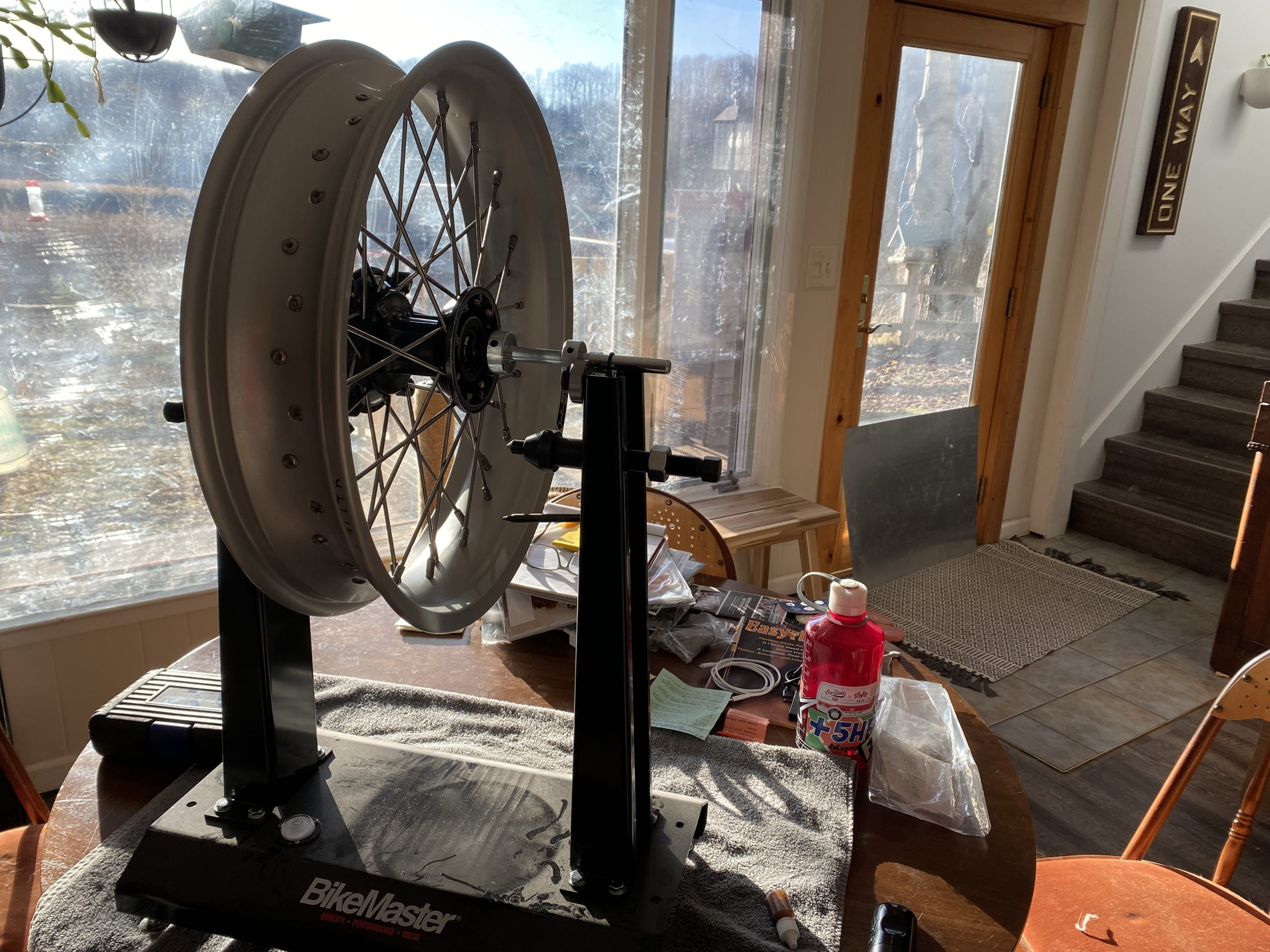 motorcycle wheel on truing stand
