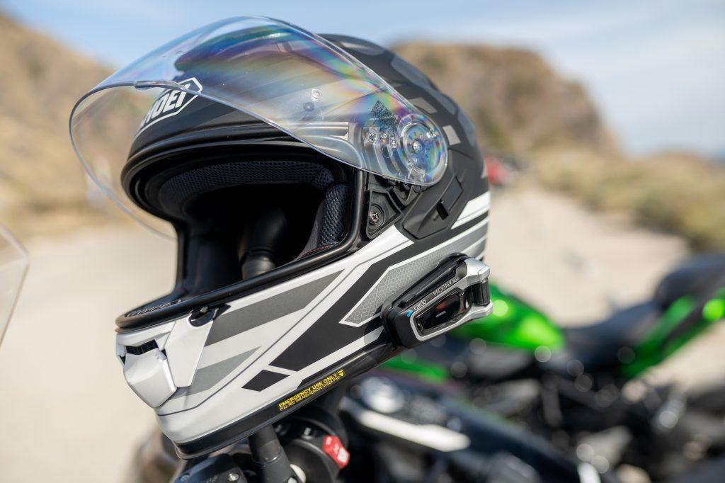shoei moto helmet with kawasaki background