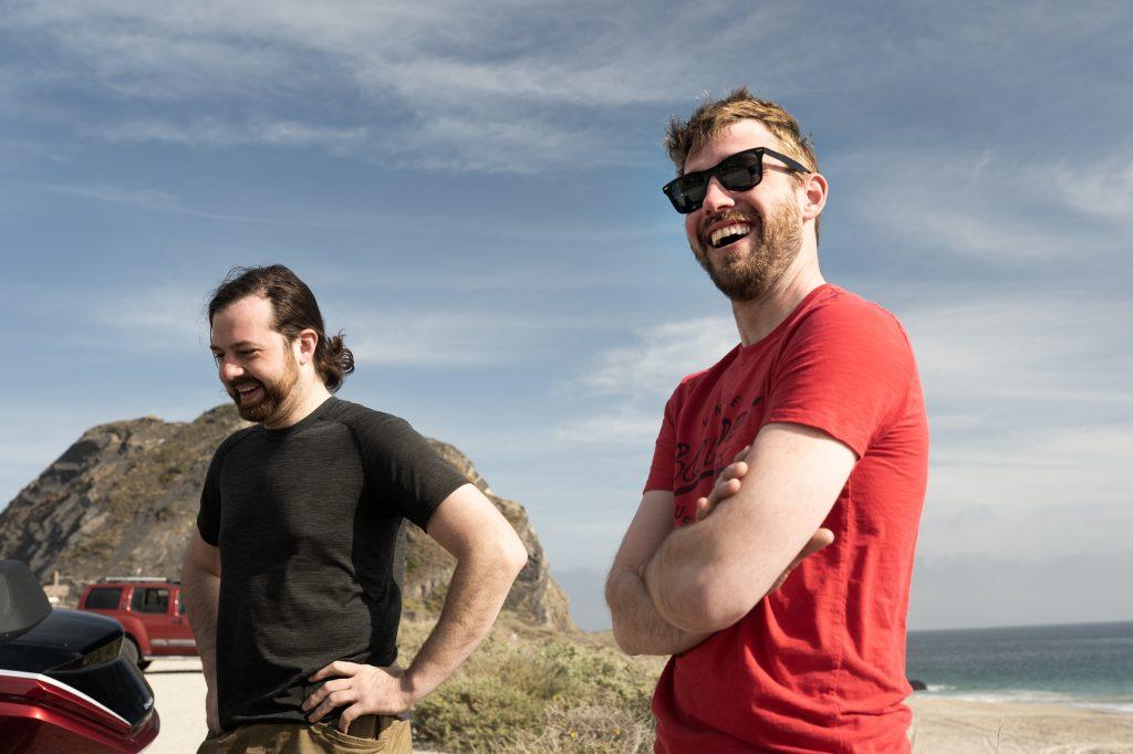moto riders laughing enjoying californian coast