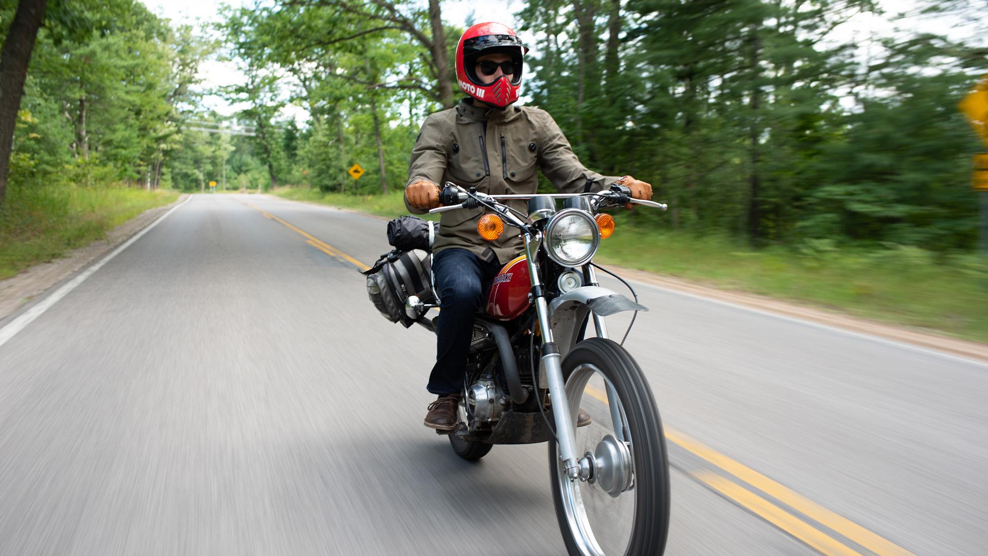 Man riding a Kawasaki Motorcycle