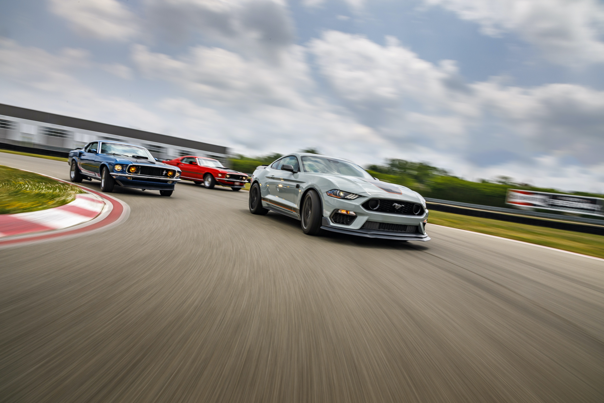 2021 Mustang Mach 1 white with classics on track cornering action