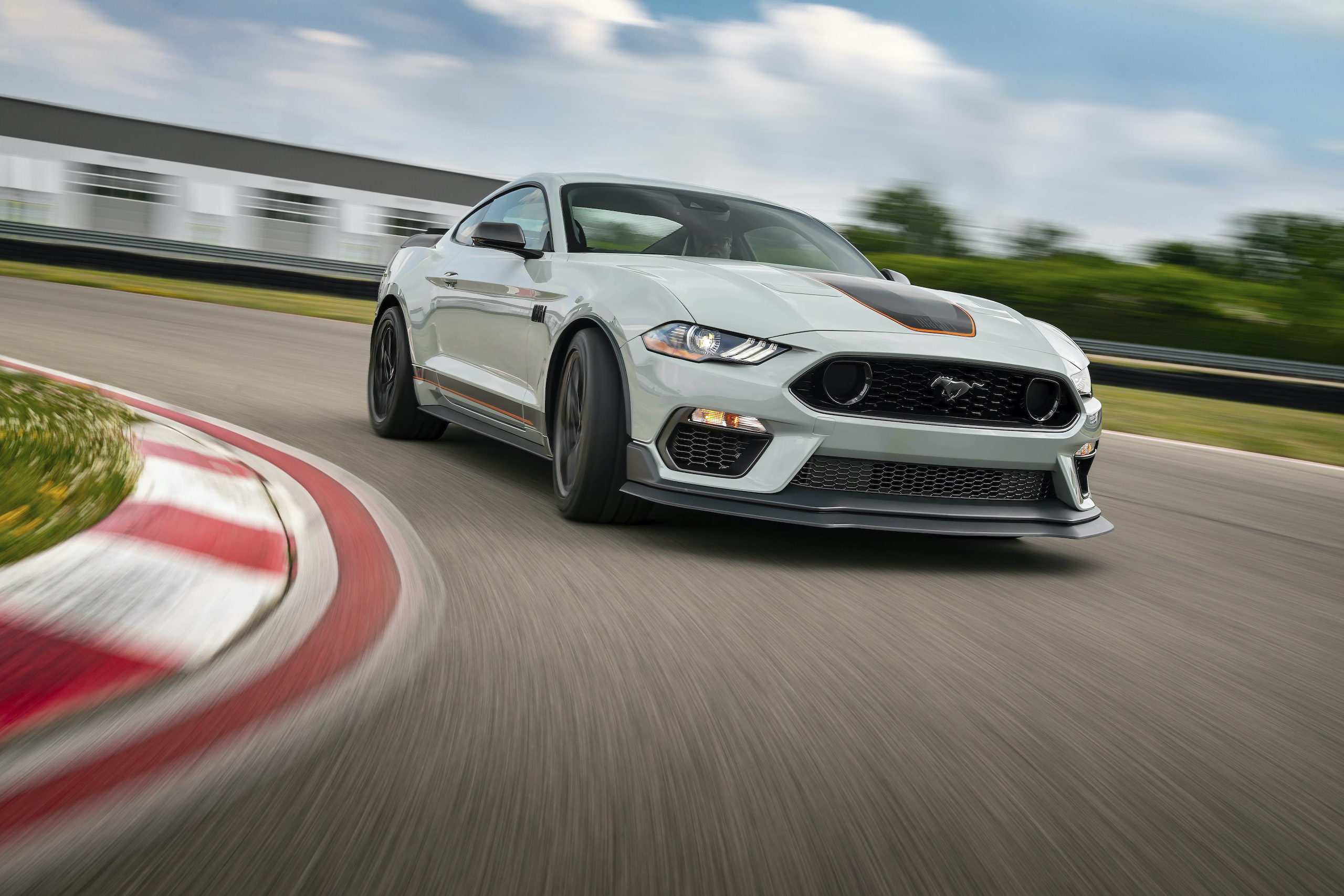 2021 Mustang Mach 1 white front three-quarter cornering track action