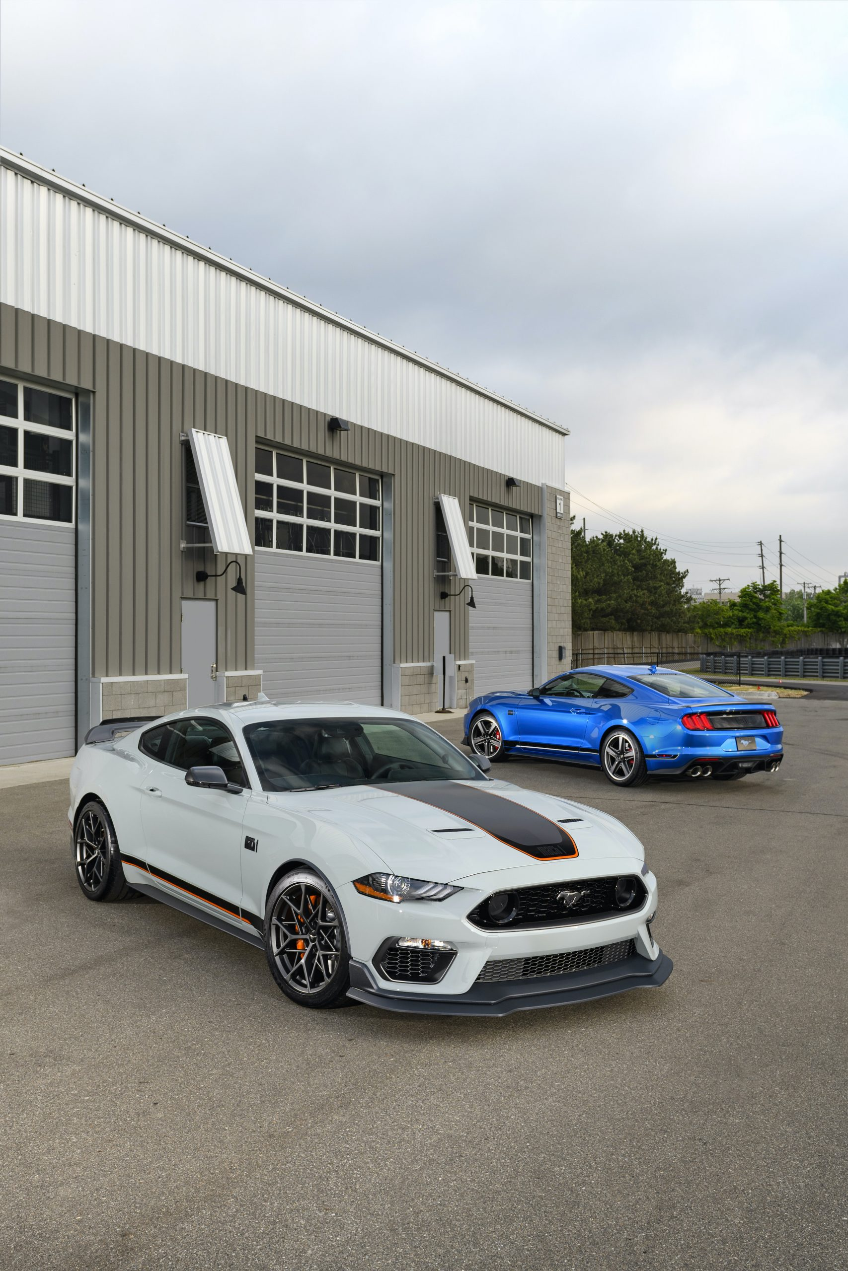 2021 Mustang Mach 1 white front three-quarter with blue vertical