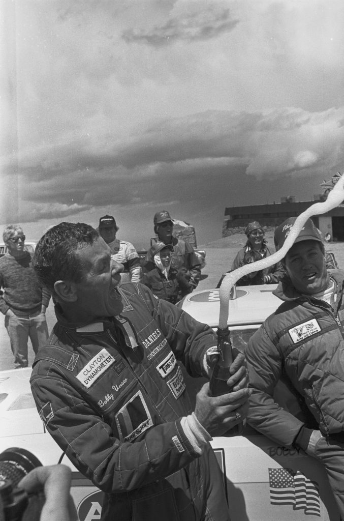 Bobby Unser Celebrating Pikes Peak Champagne