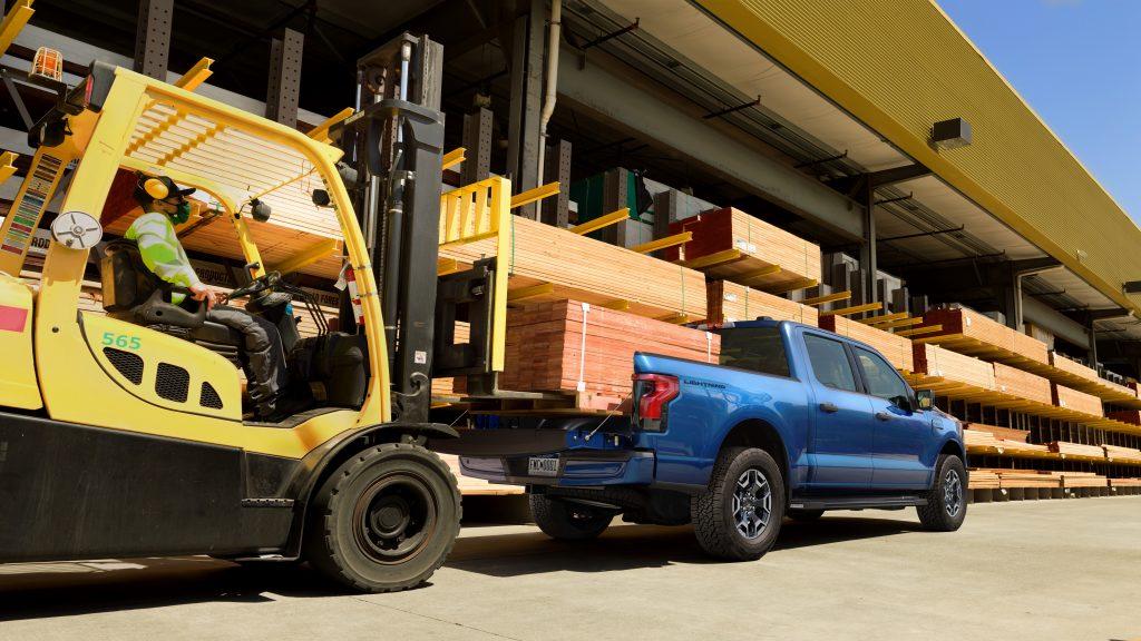 Ford F-150 Lightning EV rear three-quarter construction payload
