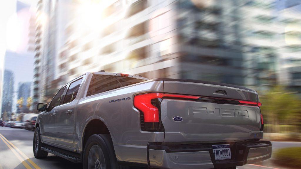 Ford F-150 Lightning EV rear three-quarter urban action