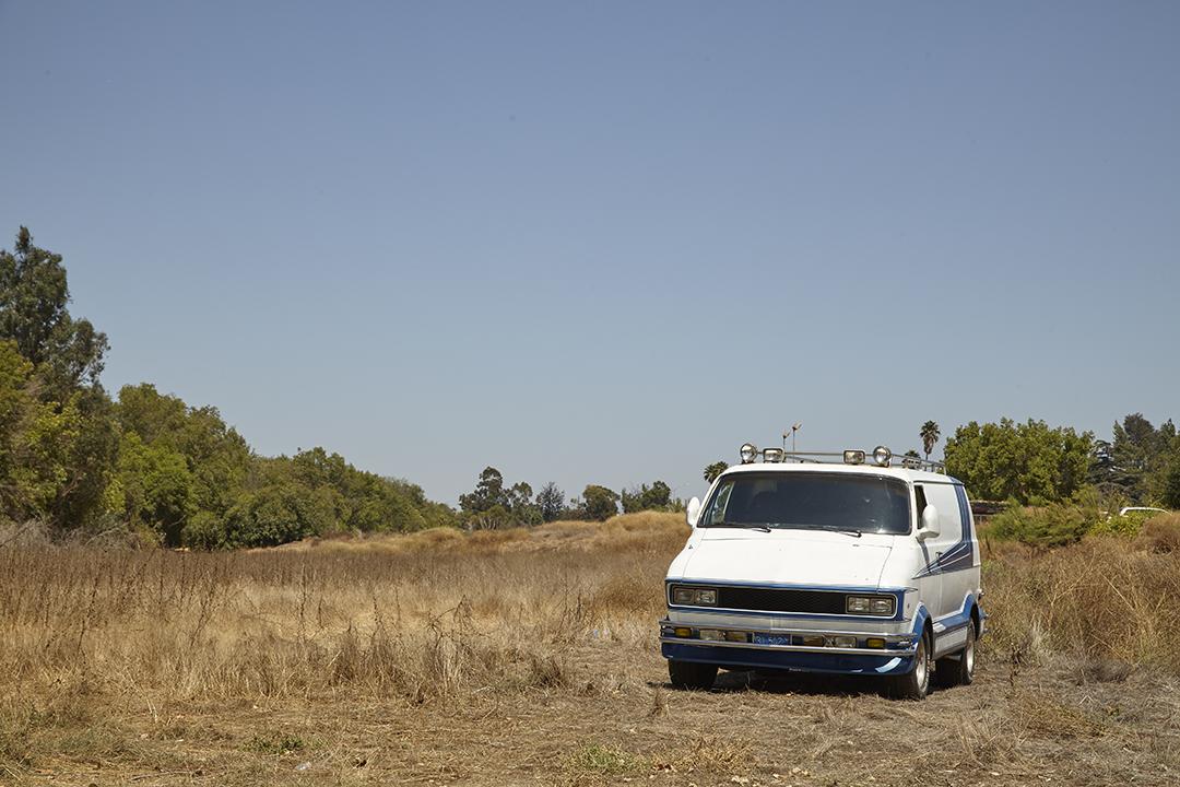 Deans Machine Van front in field