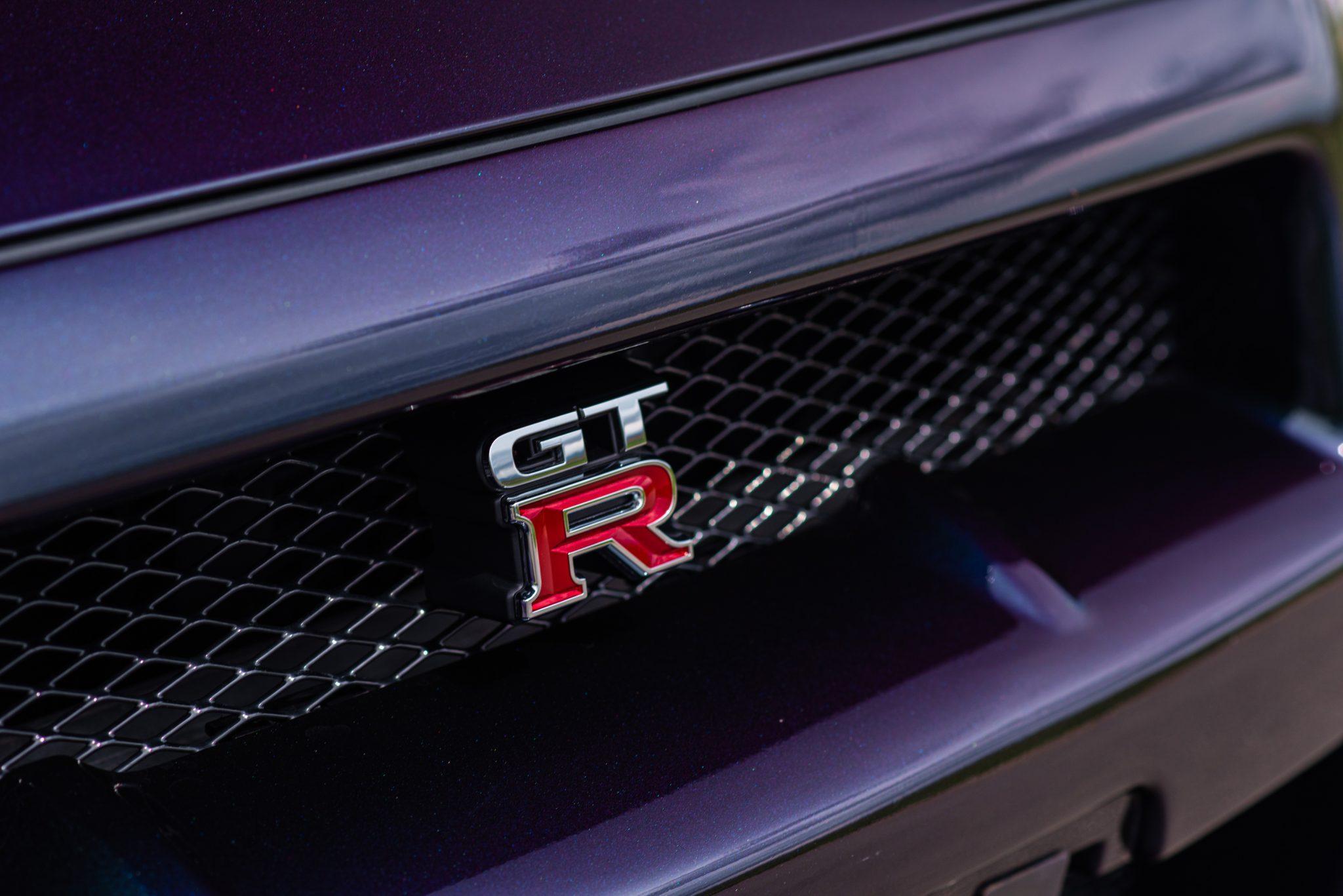 1999 Nissan Skyline GT-R V-Spec grille badge