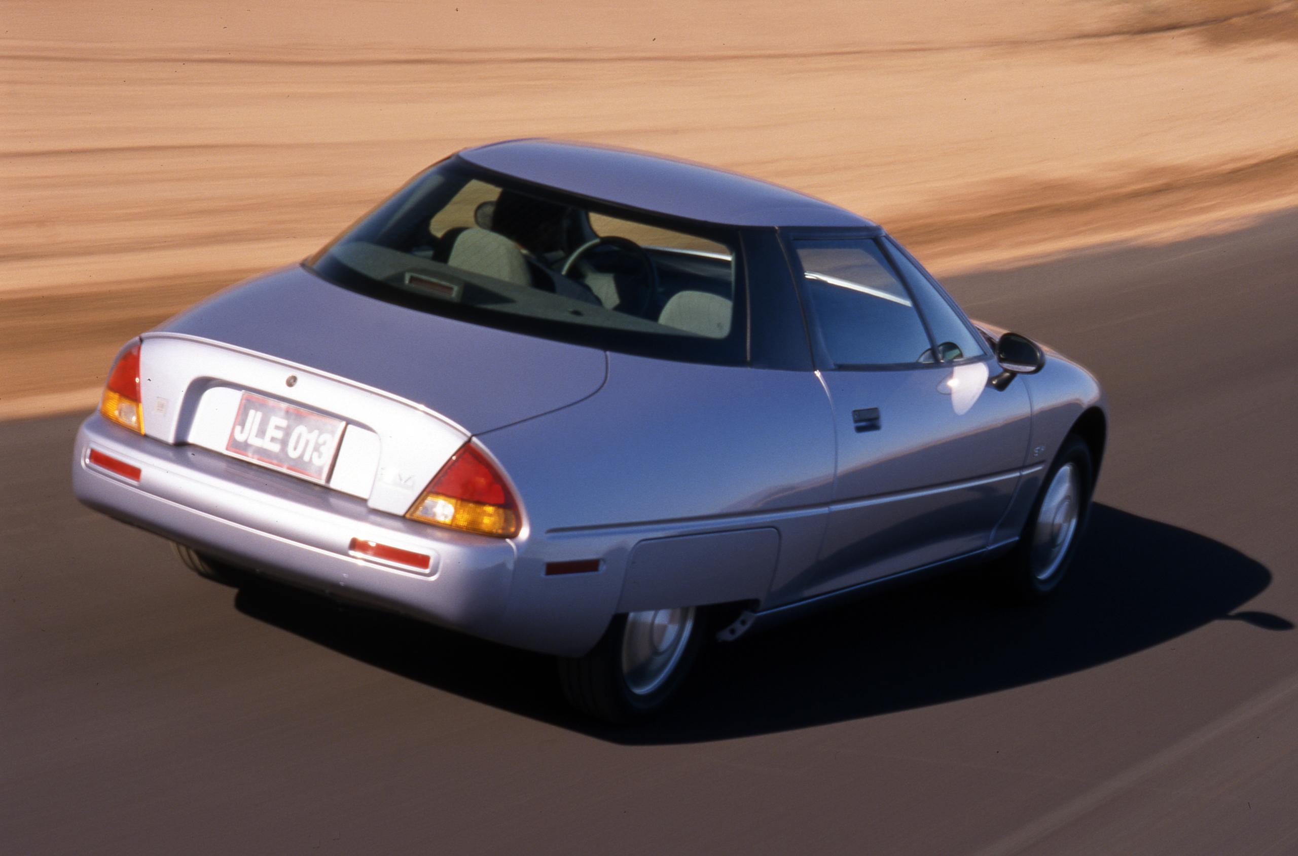 1997 GM EV1 Electric Vehicle rear three-quarter action