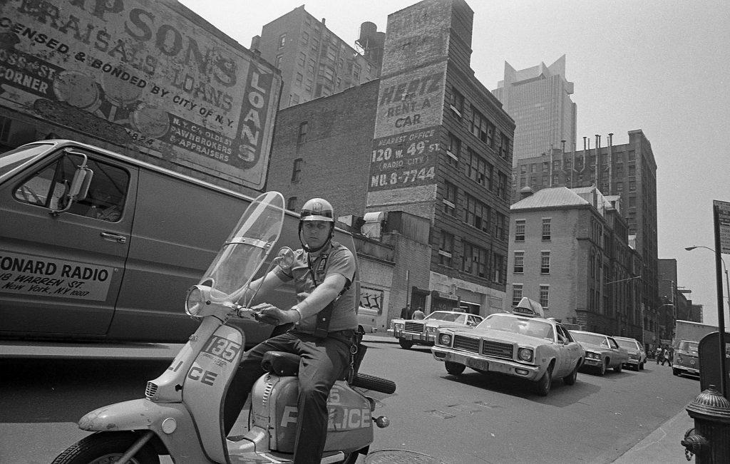 NYPD Officer Patroling Midtown Manhattan on Lambretta