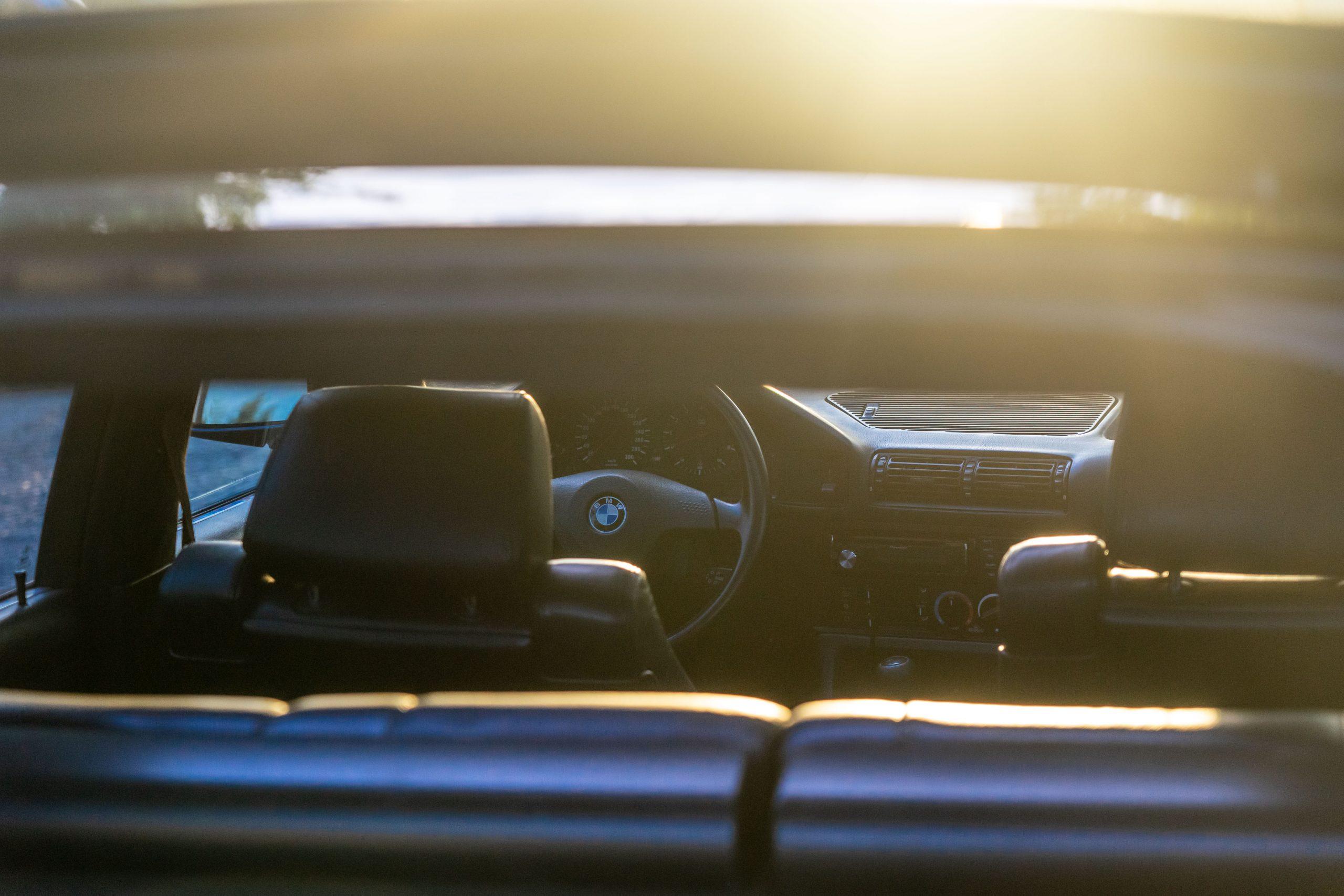 M5 Touring interior sunset glow