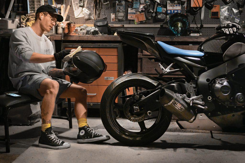 CBR 1000rr rider cleans helmet in garage