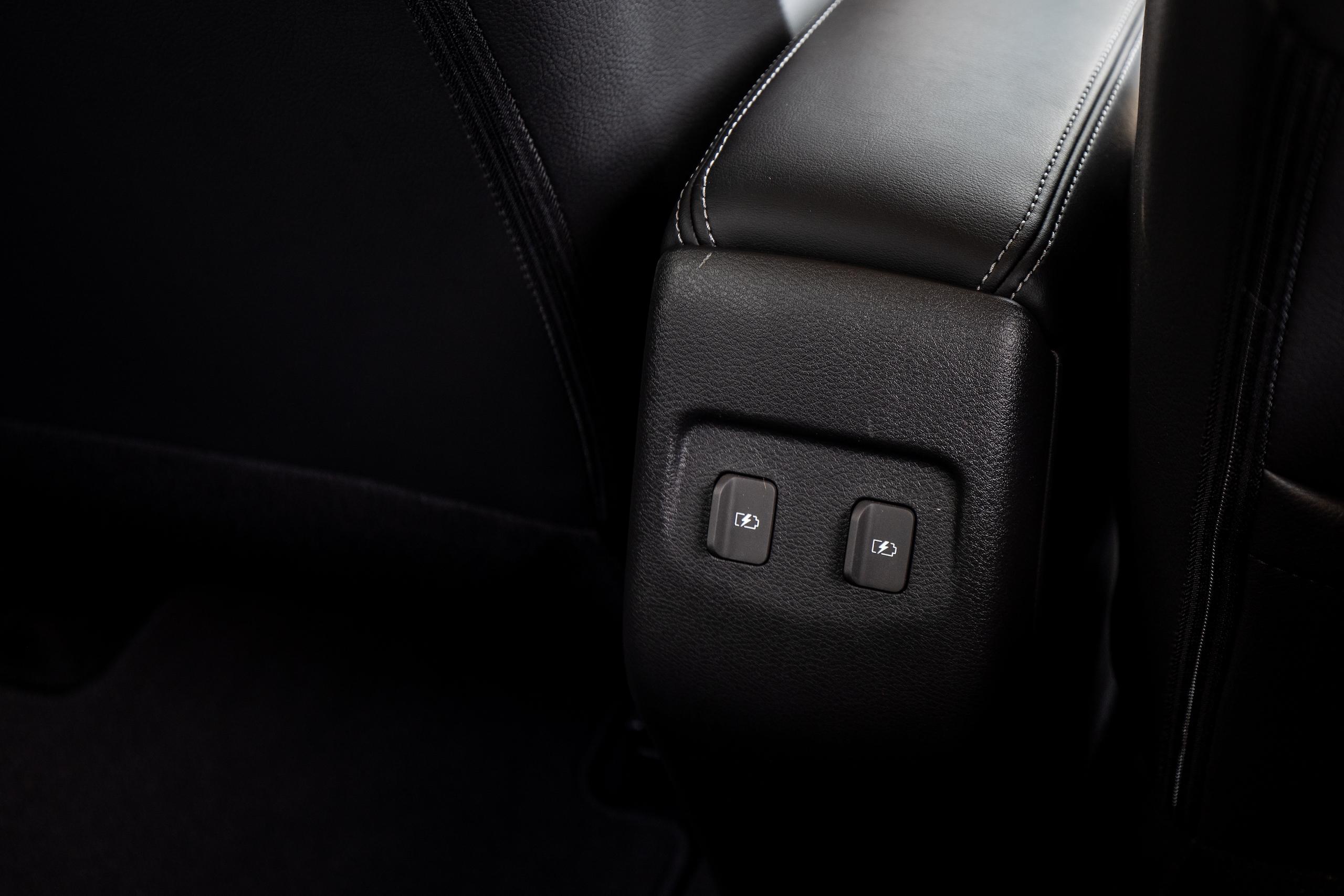 Nissan Kicks interior rear console trim power ports