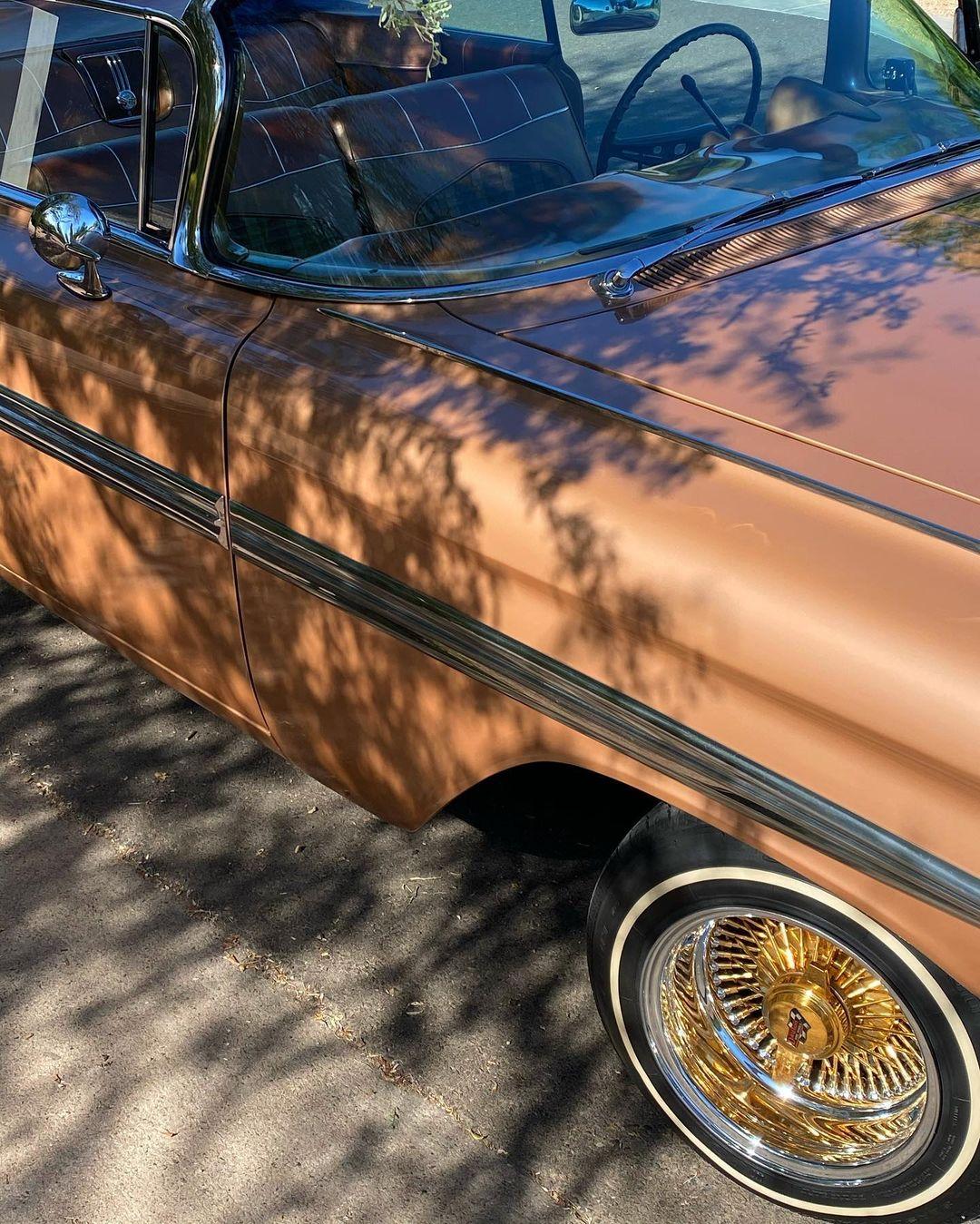 Devin Booker Impala rim and quarter panel