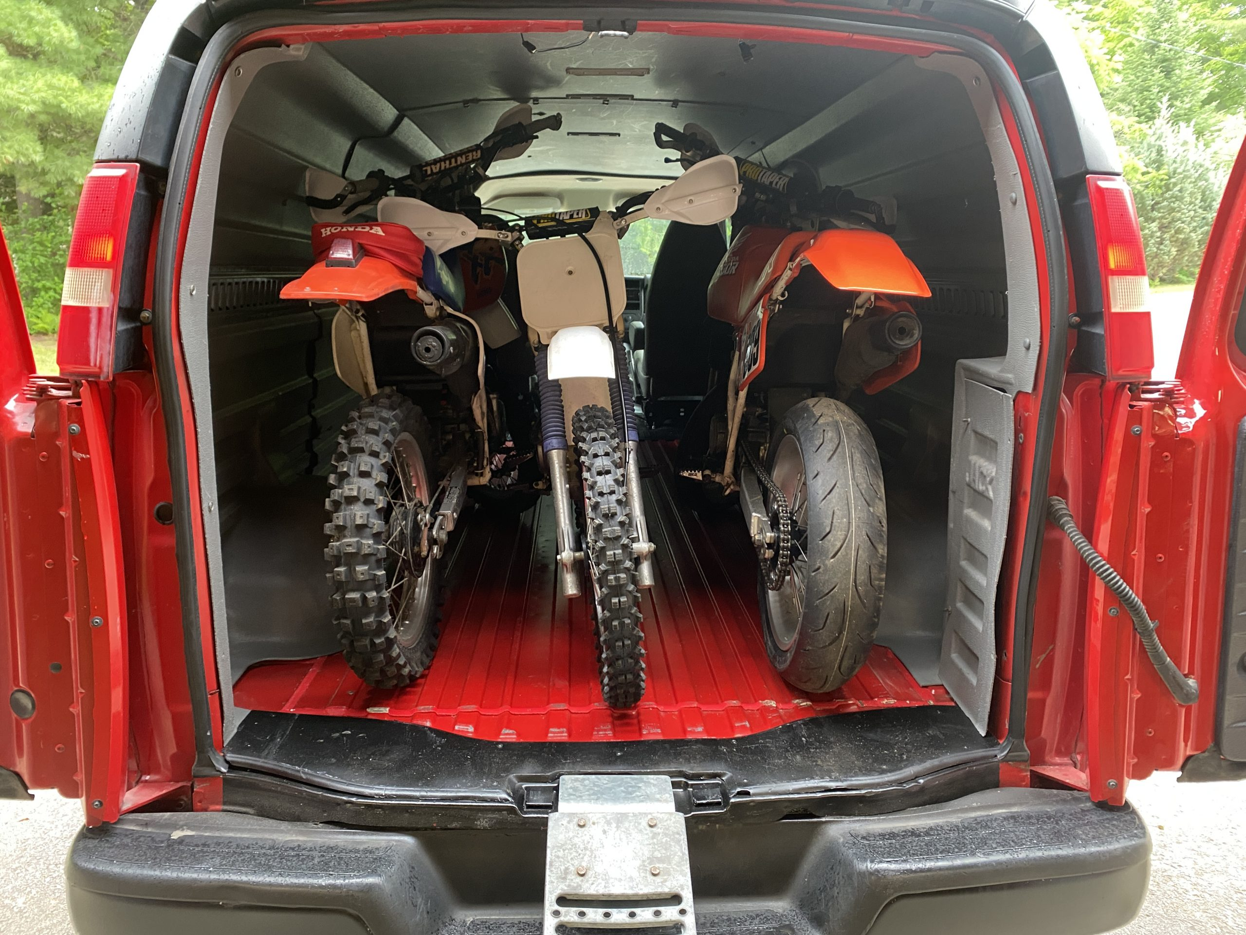 three motorcycles in Chevrolet Express