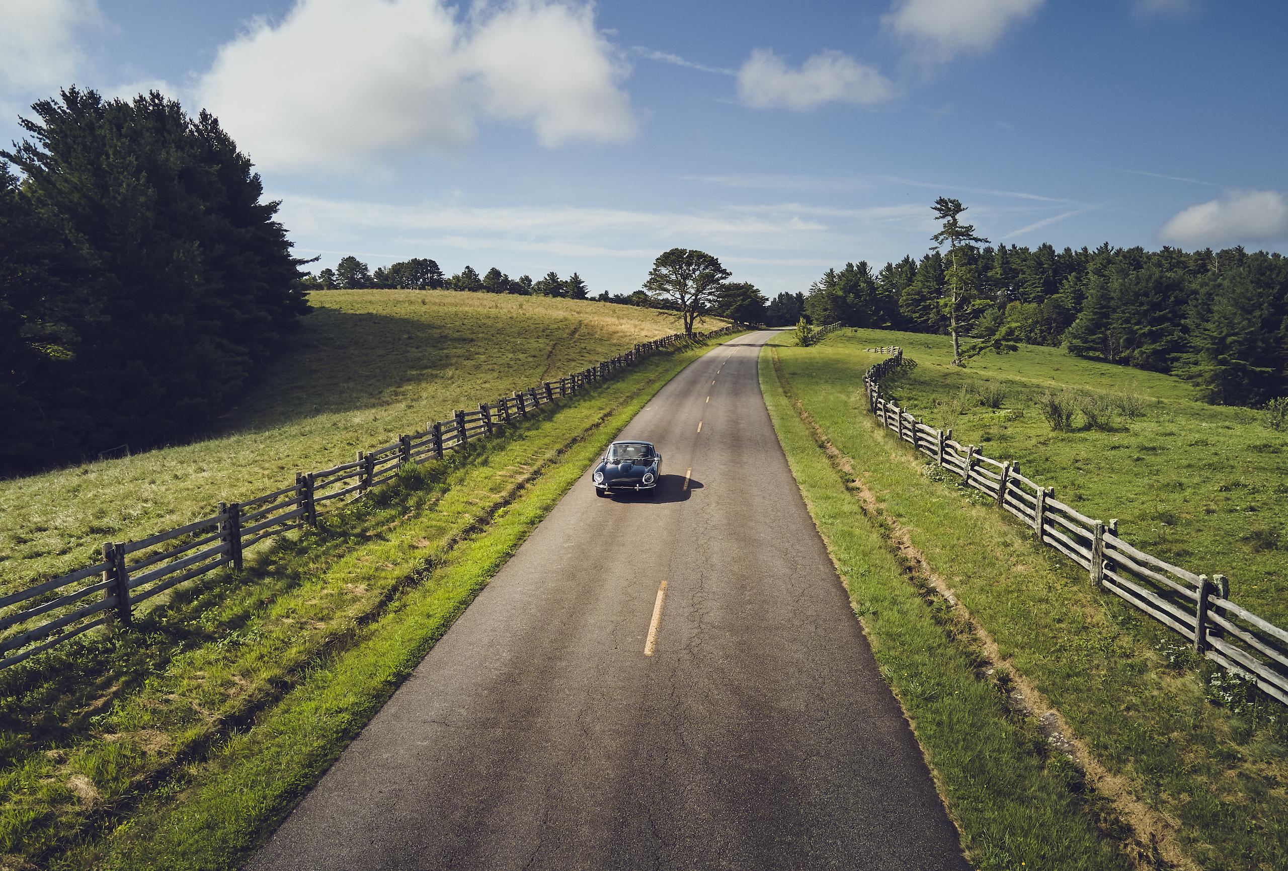 Jaguar E-Type rural road front action