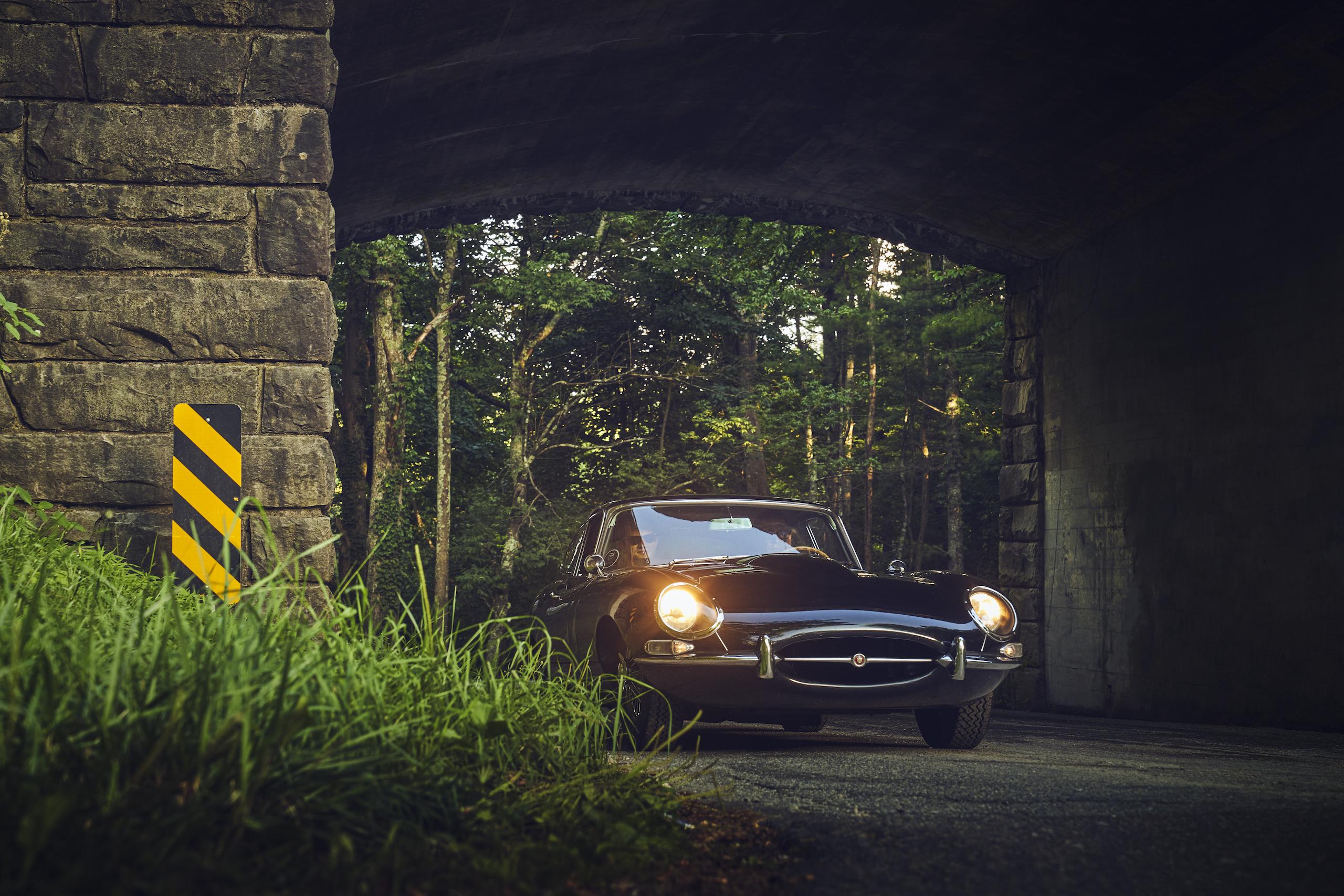 Jaguar E-Type front three-quarter under bridge