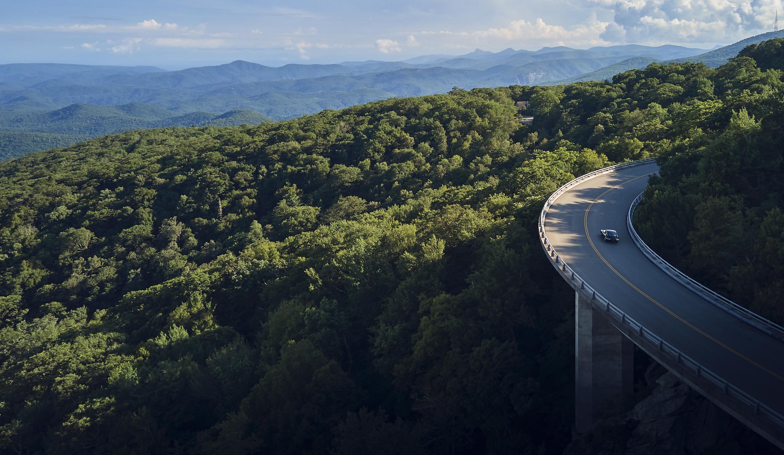 Jaguar E-Type mountain range bridge
