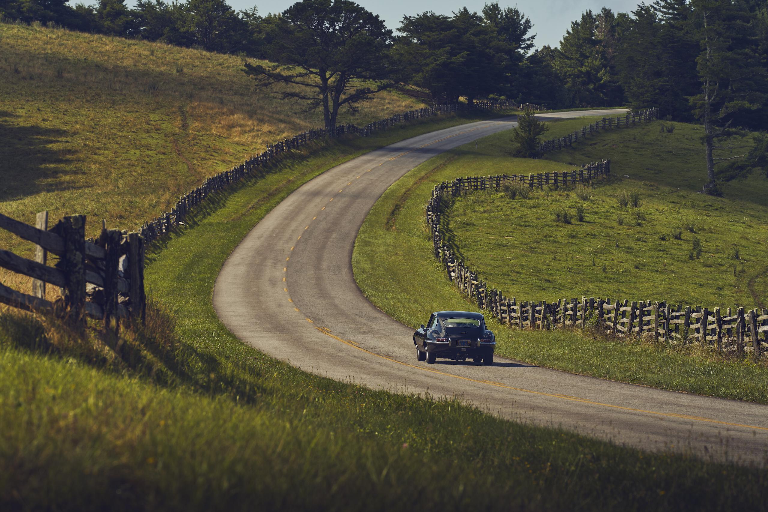 Jaguar E-Type rear rural road
