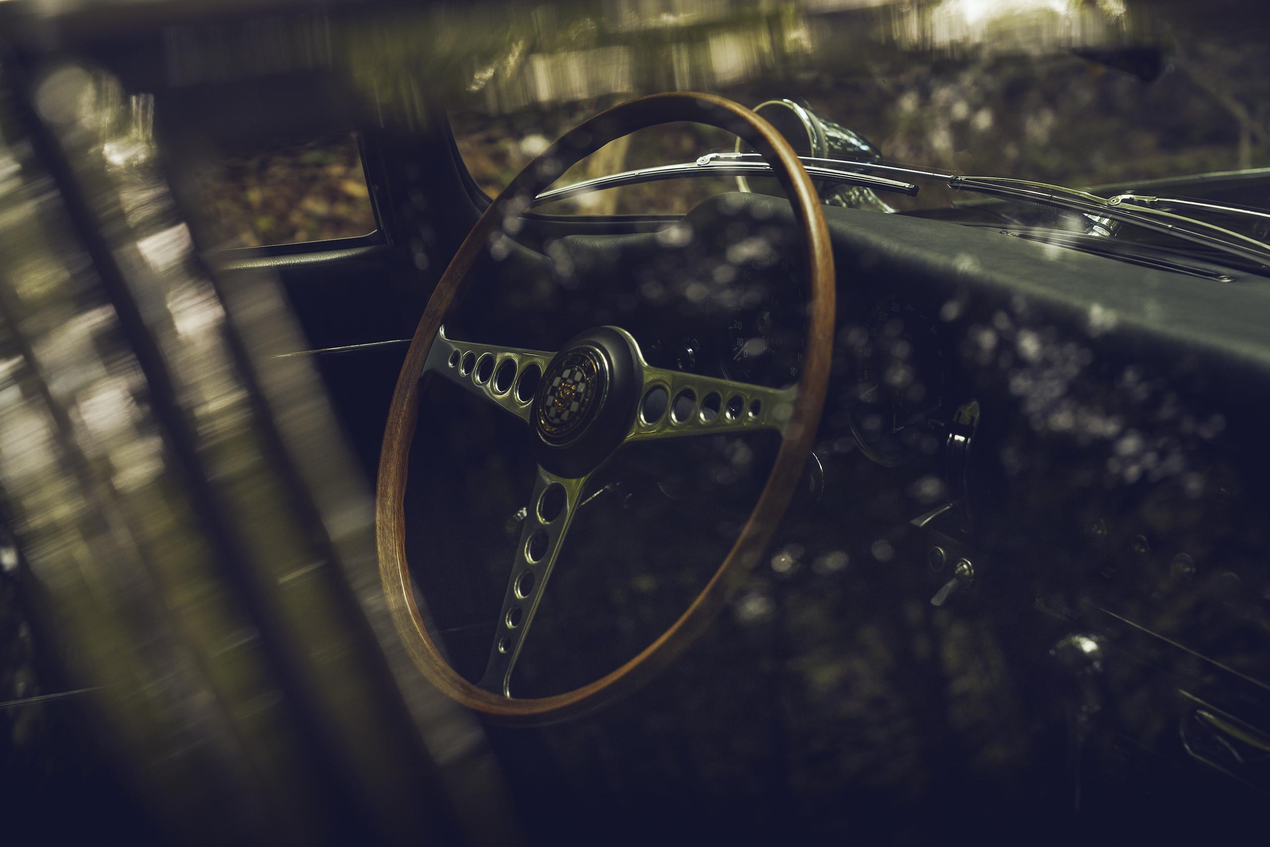 Jaguar E-Type interior steering wheel through window