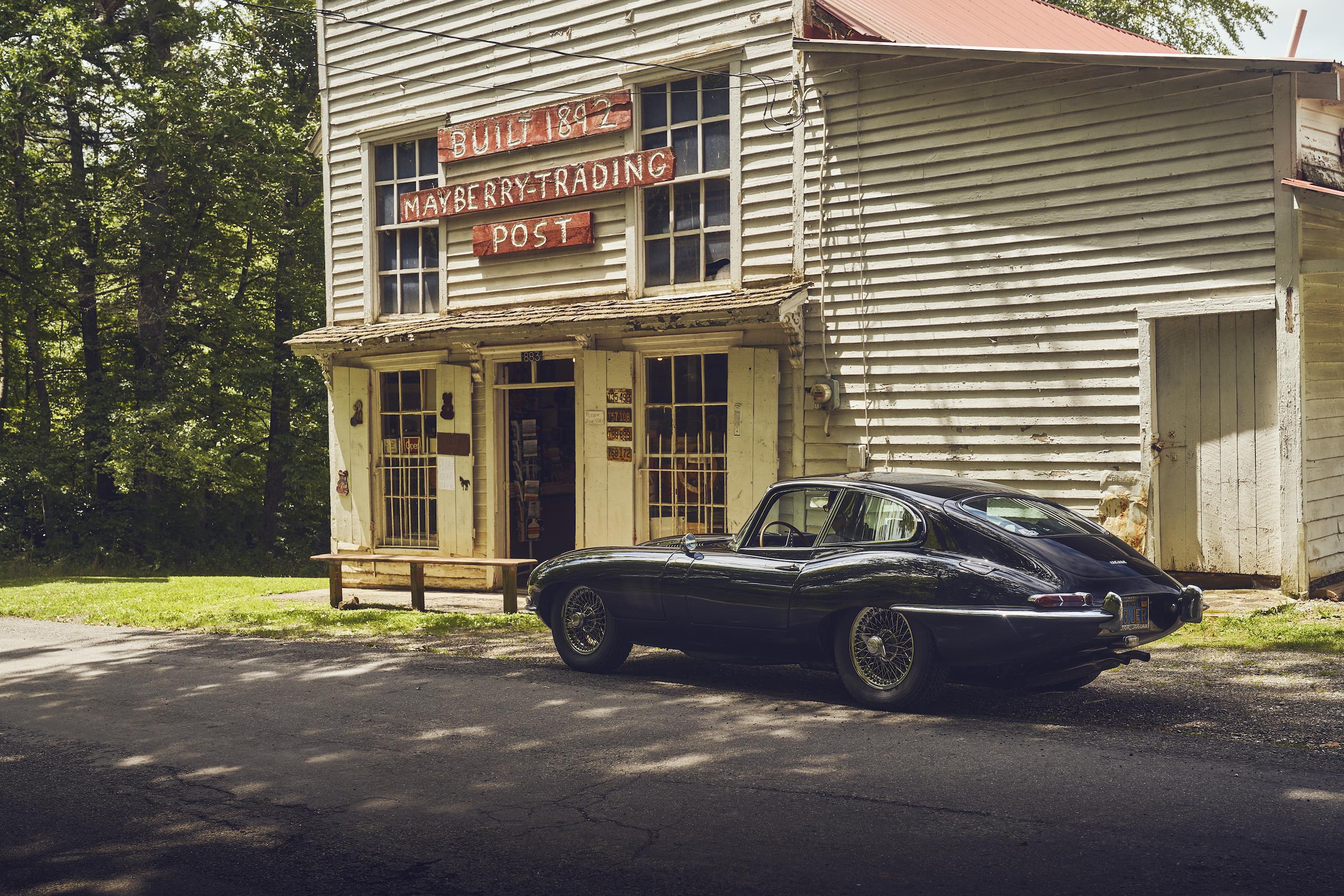 Jaguar E-Type trading post parked
