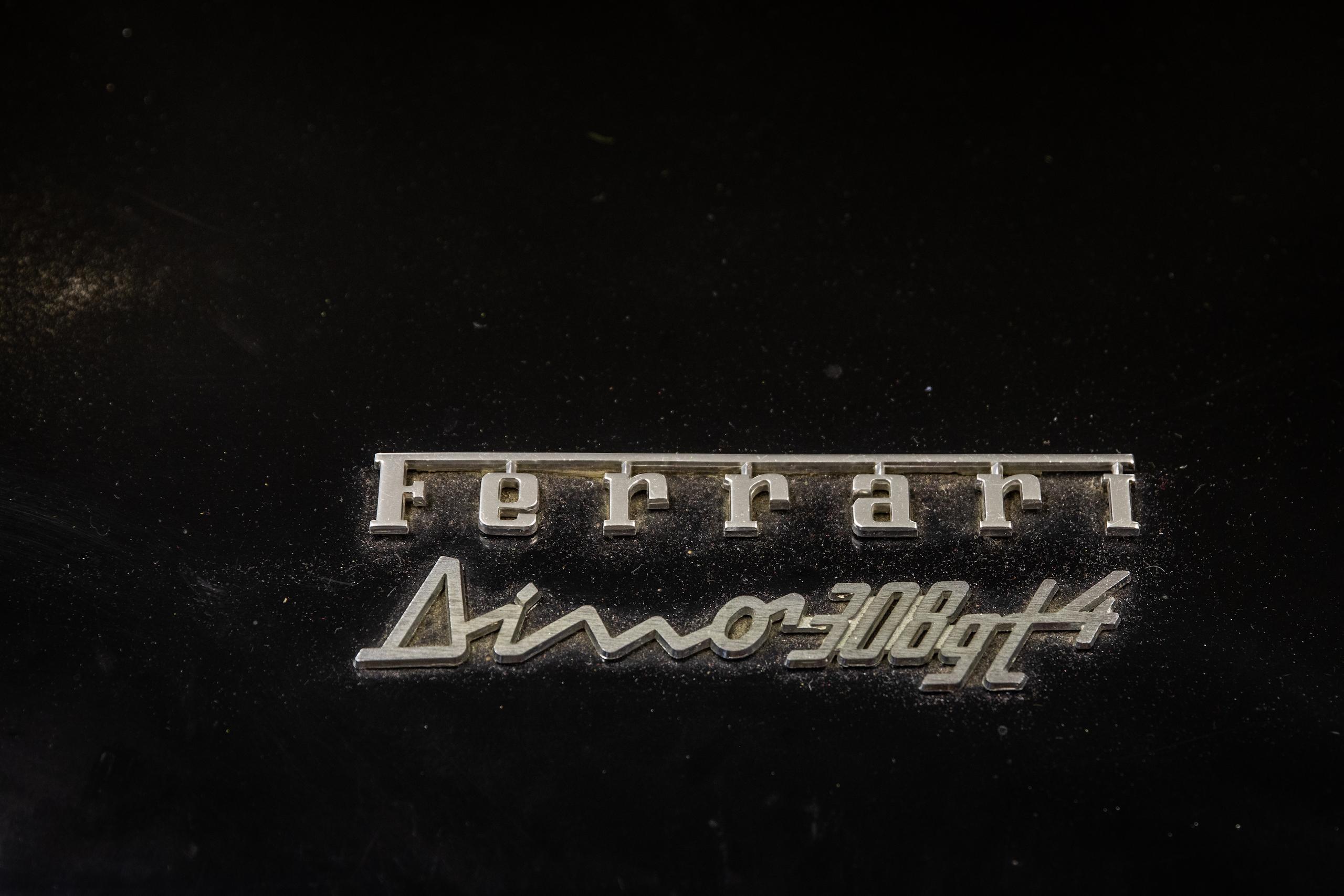 Ferrari Dino badge script lettering