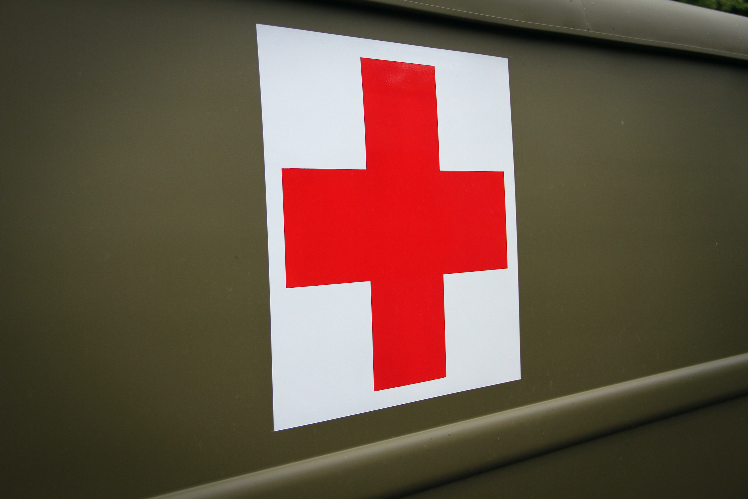 Military vehicle convoy red cross