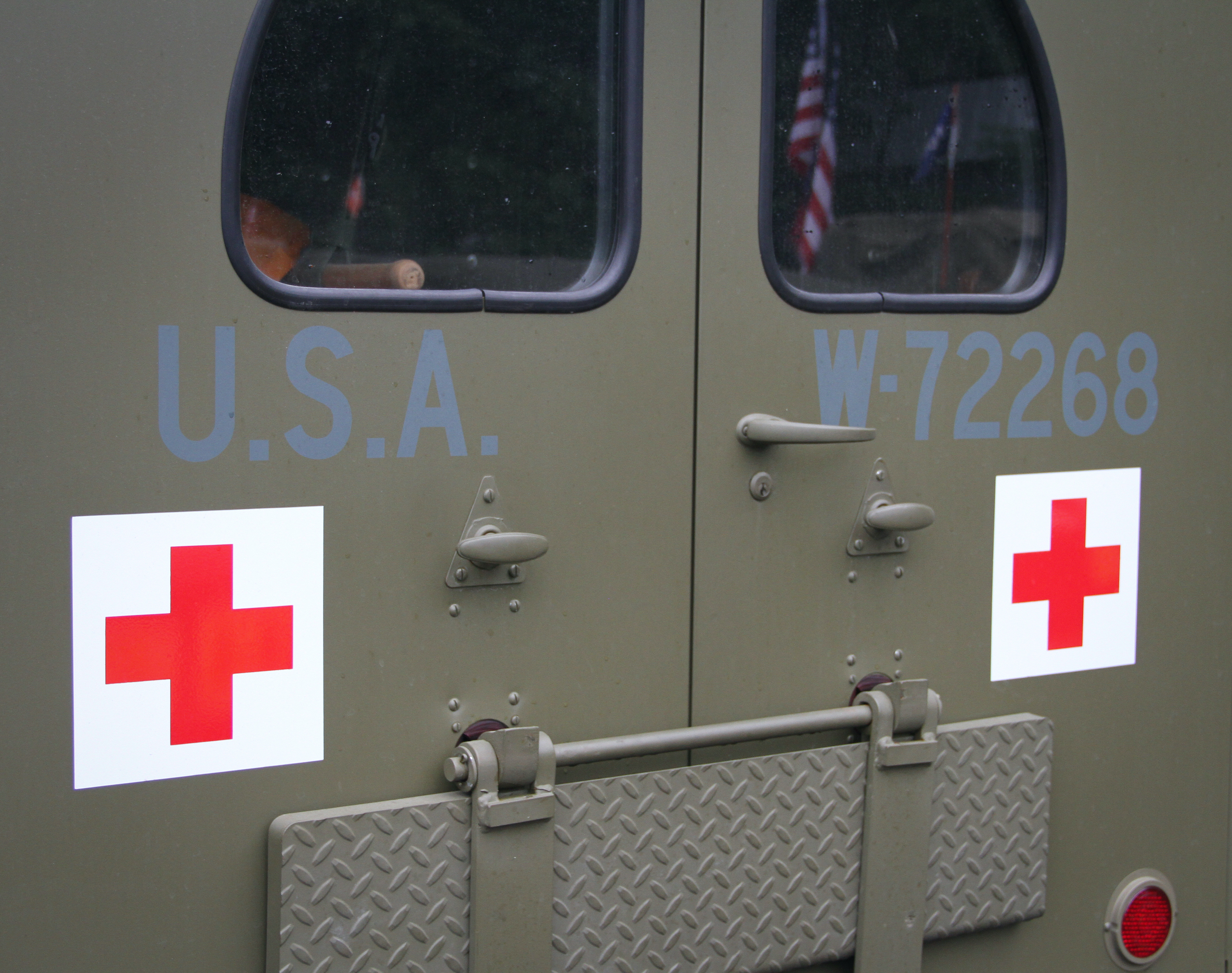 Military vehicle convoy ambulance rear doors