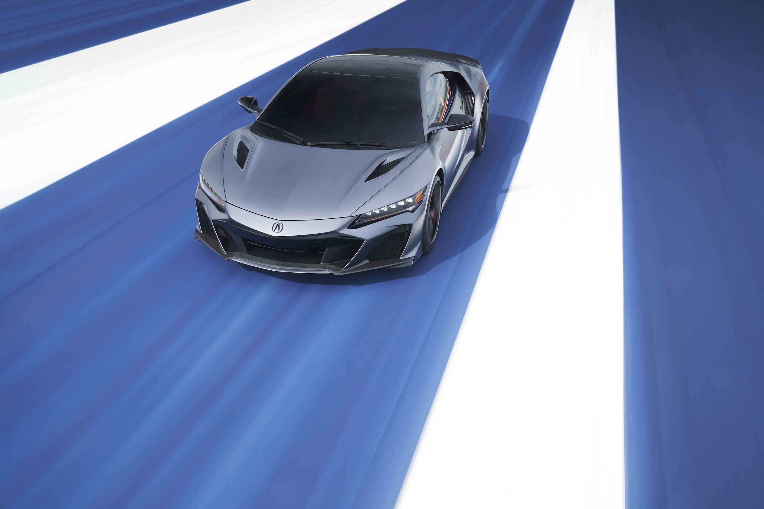 2022 Acura NSX Type S front three-quarter action over blue