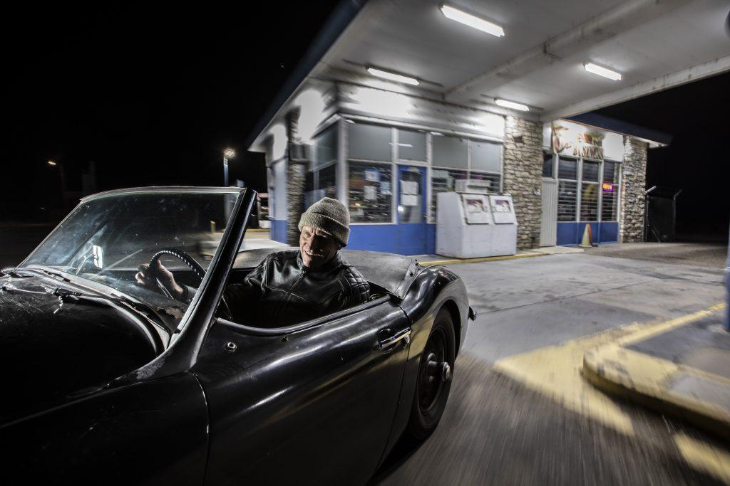 Austin-Healey night leaving station