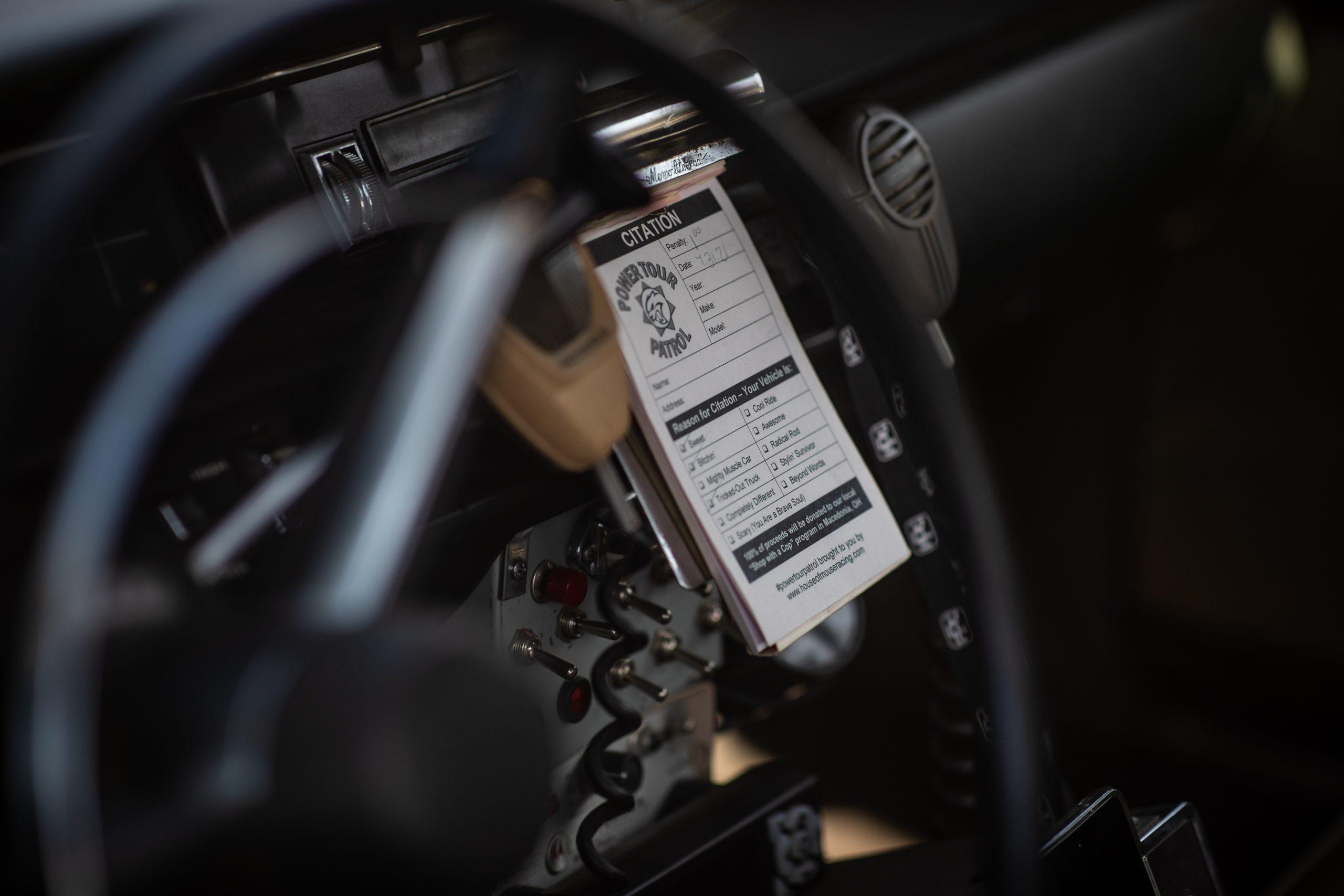 Roadkill Nights 2021 cop car interior ticket