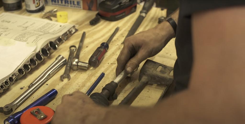 hands repairing corvair shifter