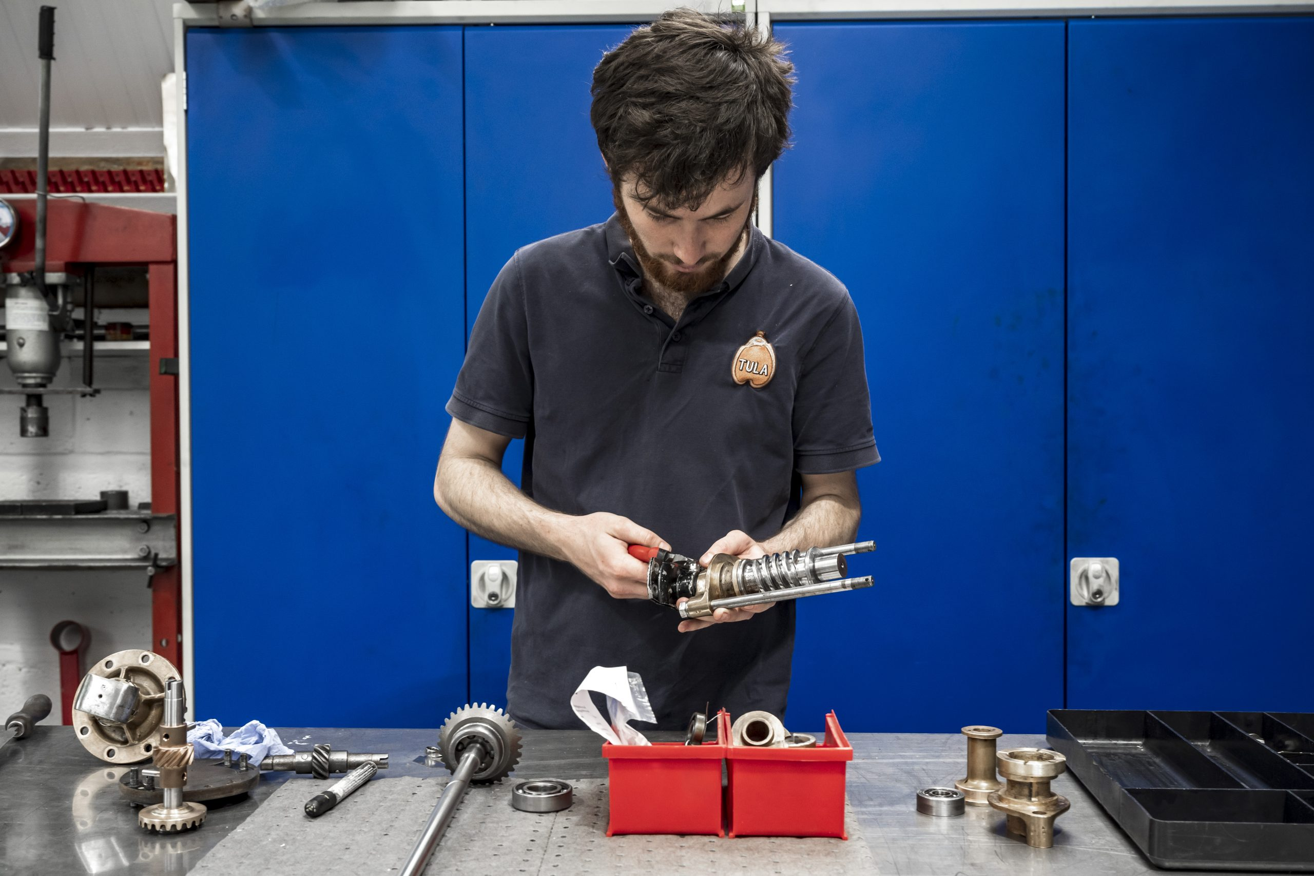 Tula Precision craftsman working hand tools