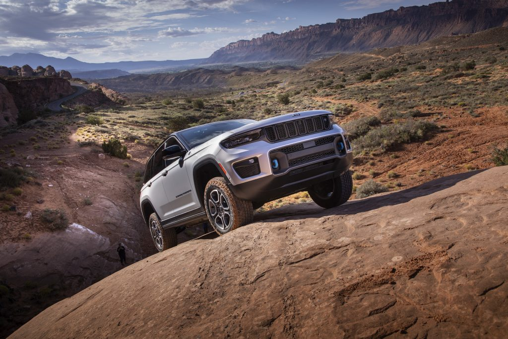2022 Jeep Grand Cherokee Trailhawk 4xe right front three quarter up rocks
