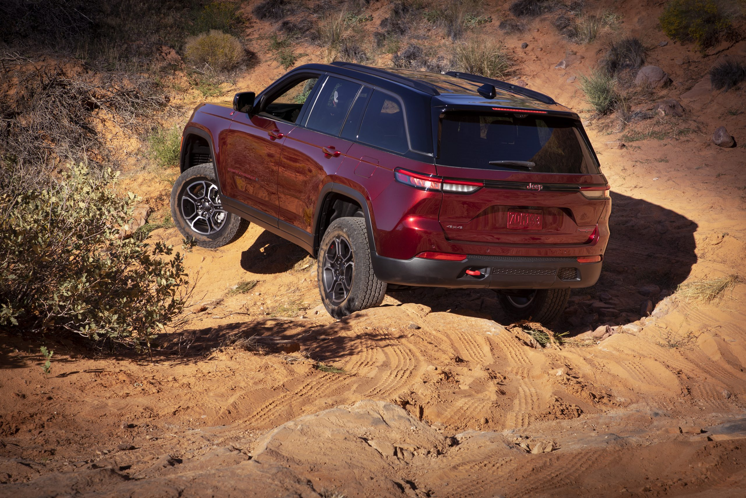 2022 Jeep Grand Cherokee Trailhawk rear three quarter flexing